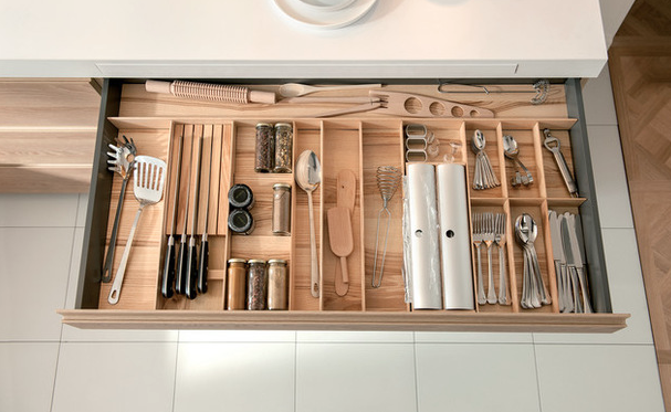 What a perfect use for that skinny shallow drawer! Adding the right separators maximizes it's space and eliminate the junk drawer where things go to die.