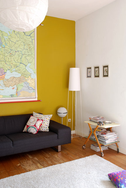 I don't think I ever would have considered a yellow but this mustard wall looks great and is a strong contender. I think it would make the room look stylish but warm and bright.