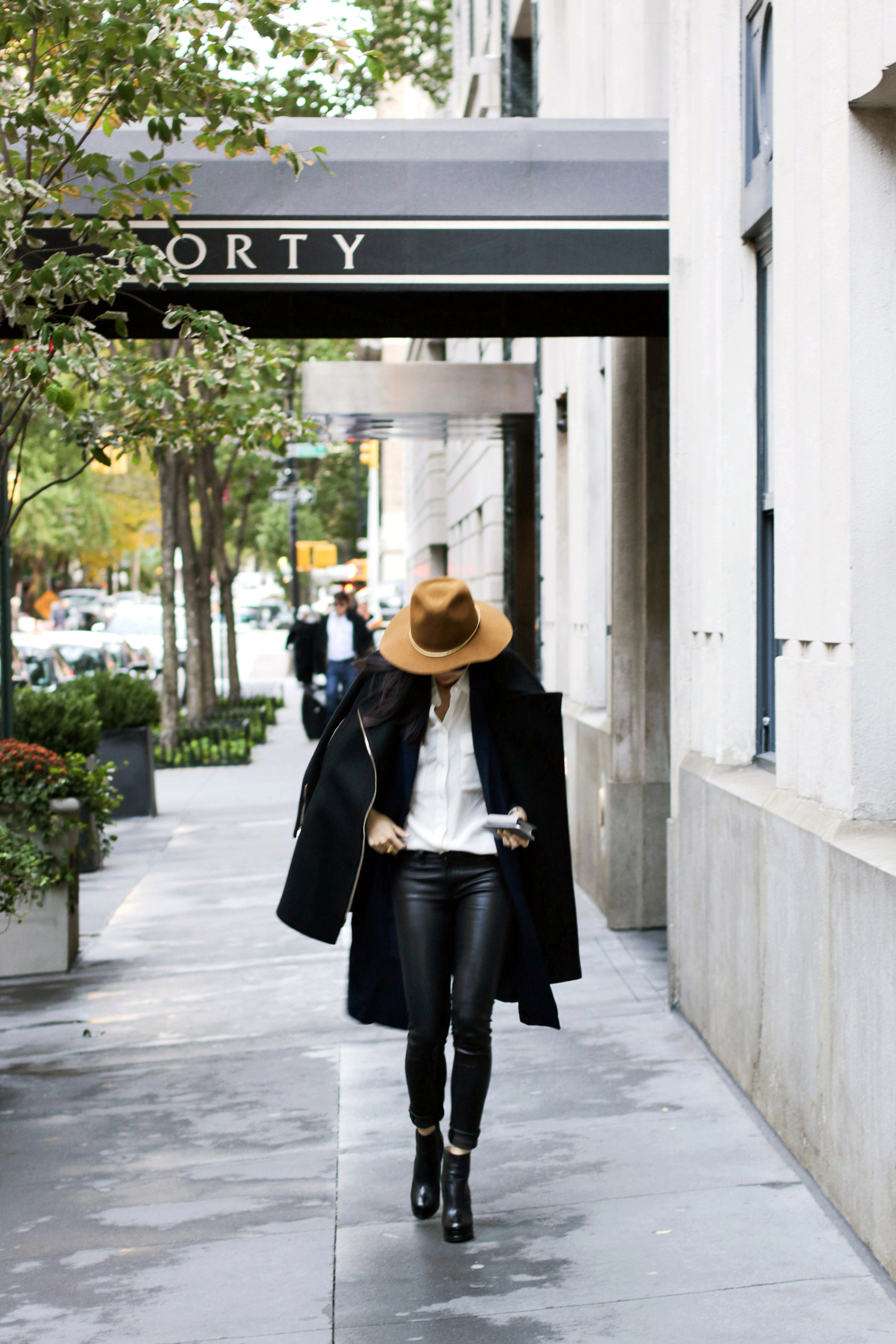 Equipment Top ,  Rag & Bone Leather Jeans ,  Asos Duster Coat ,  Stella McCartney Coat ,  Janessa Leone Hat ,  The Row Sunglasses ,  Gjenmi Necklace , Chanel Shoes and Bag