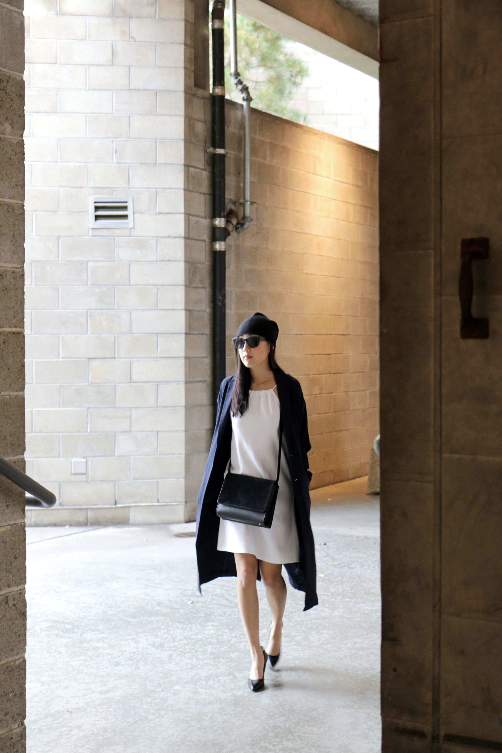 Marie Hell Tied Tunic Dress ,  Asos Coat ,  Everlane Bag ,  Acne Studios Sunglasses ,  COS Beanie