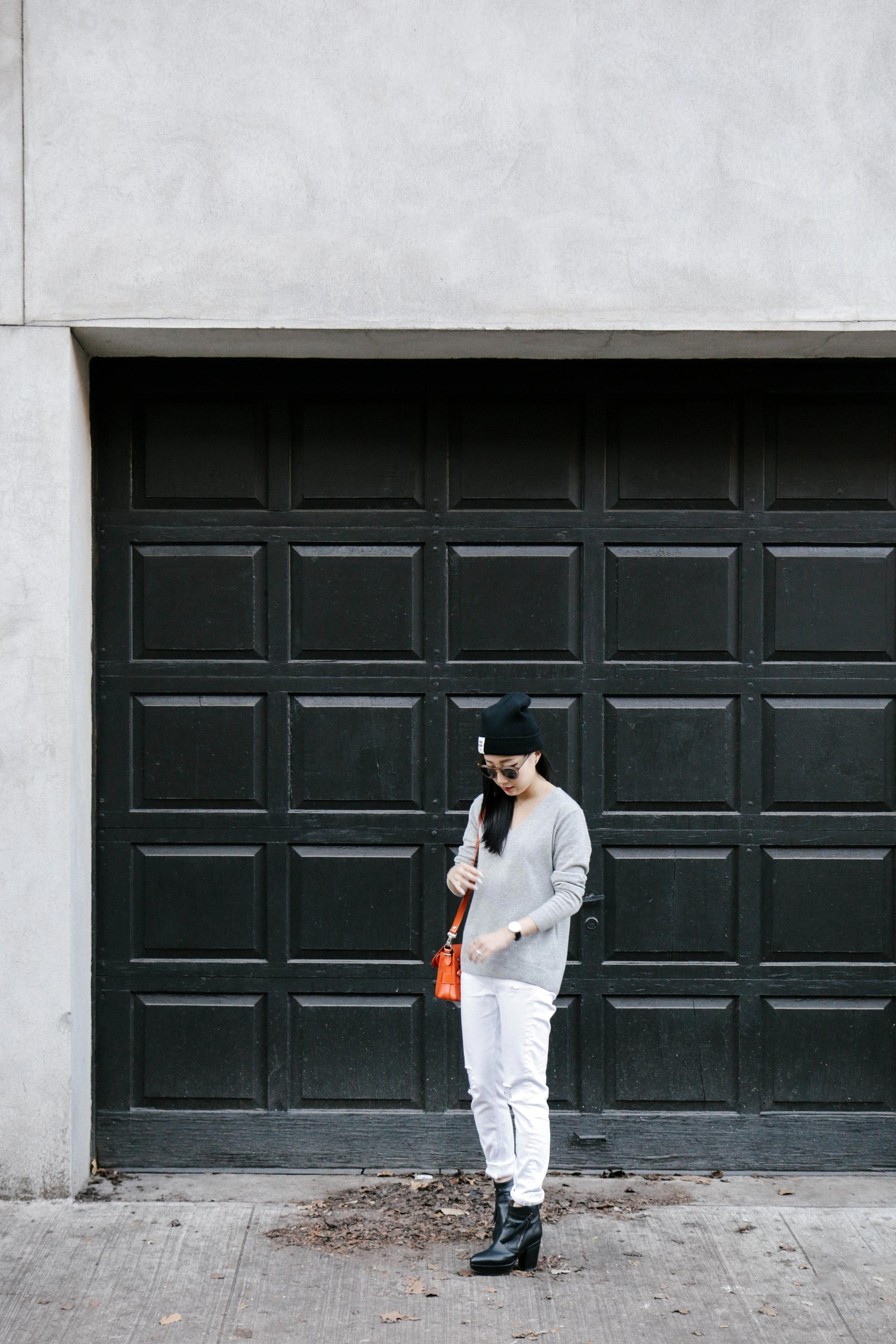 Stella McCartney Coat ,  Everlane Sweater , Rag & Bone Jeans,  Acne Studios Boots , Proenza Schouler Bag ( in Black ),  COS Scarf ,  Cutler and Gross Sunglasses ,  Opening Ceremony Beanie ,  Daniel Wellington Watch ,  AVEC New York Ring ,  Catbird Rings