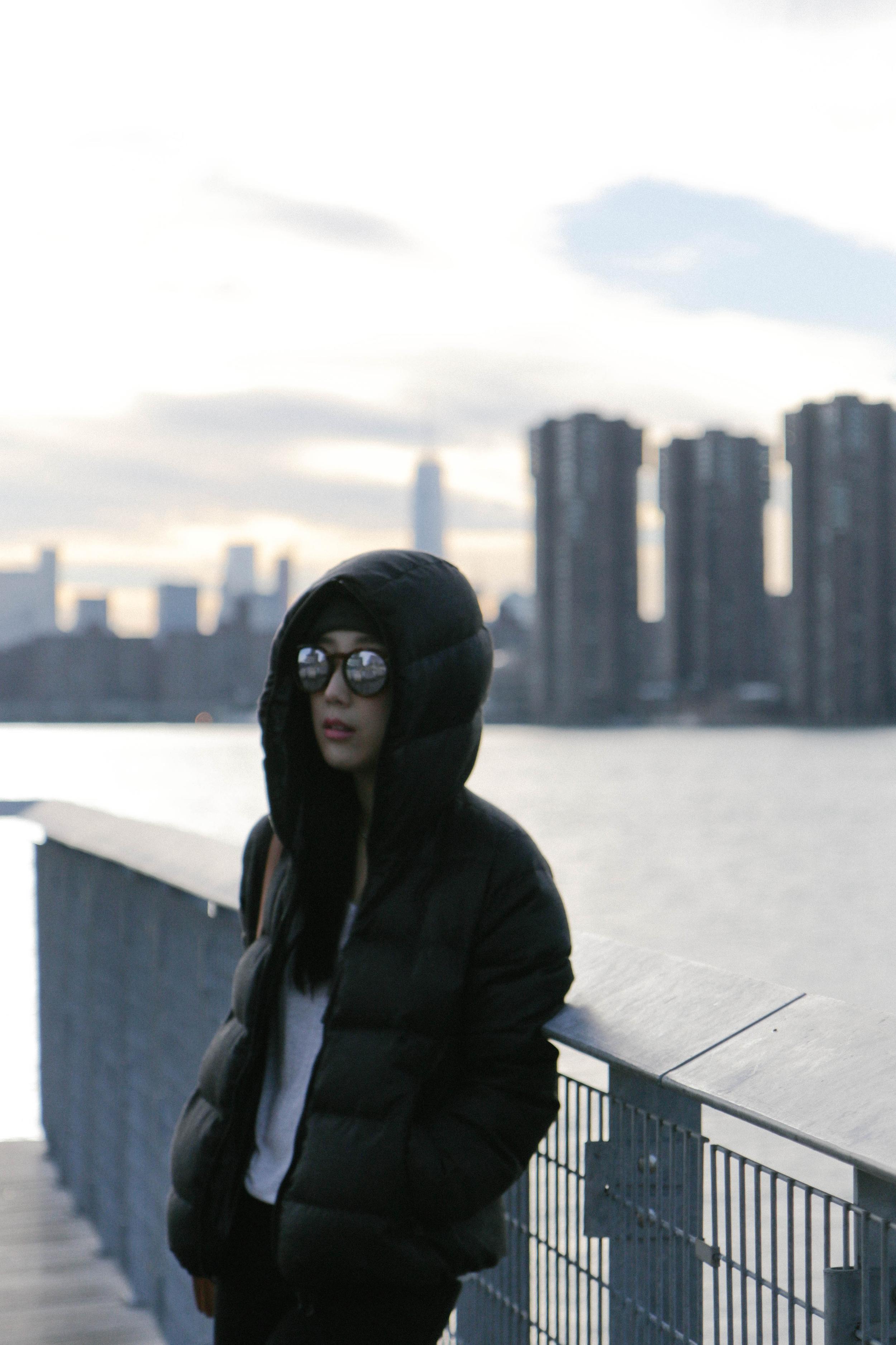 Duvetica Jacket,  T by Alexander Wang Top ,  Frame Denim Jeans , Céline Bag, Balenciaga Shoes,  Illesteva Sunglasses , Asos Beanie