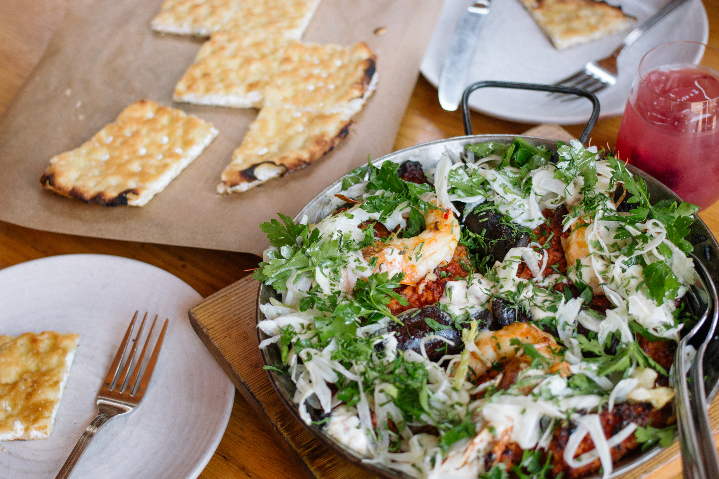 Dinner of truffle foccacia and seafood paella paired with sangria at  avec