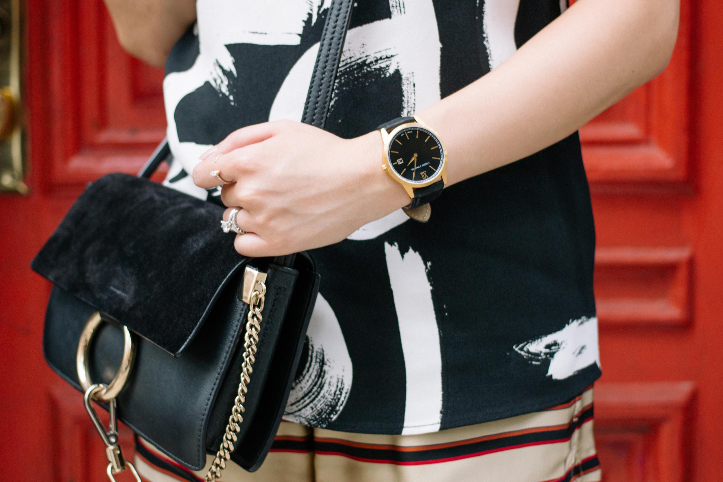 Proenza Schouler Top, Dries Van Noten Shorts,  Chloé Bag ,  Larsson & Jennings Watch ,  Mirlo Jewelry