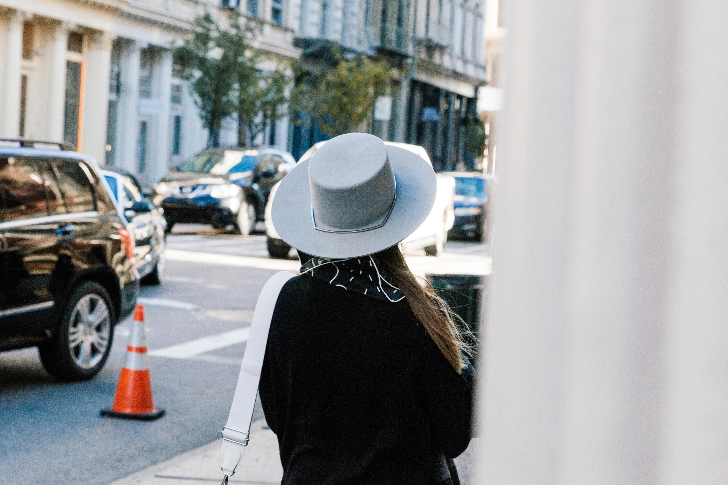 Hermes Bag ,  Isabel Marant Coat ,  Everlane Sweater ,  Rag & Bone Pants ,  Adidas Sneakers ,  Gentle Monster Sunglasses ,  Janessa Leone Hat ,  The Slow Factory Scarf