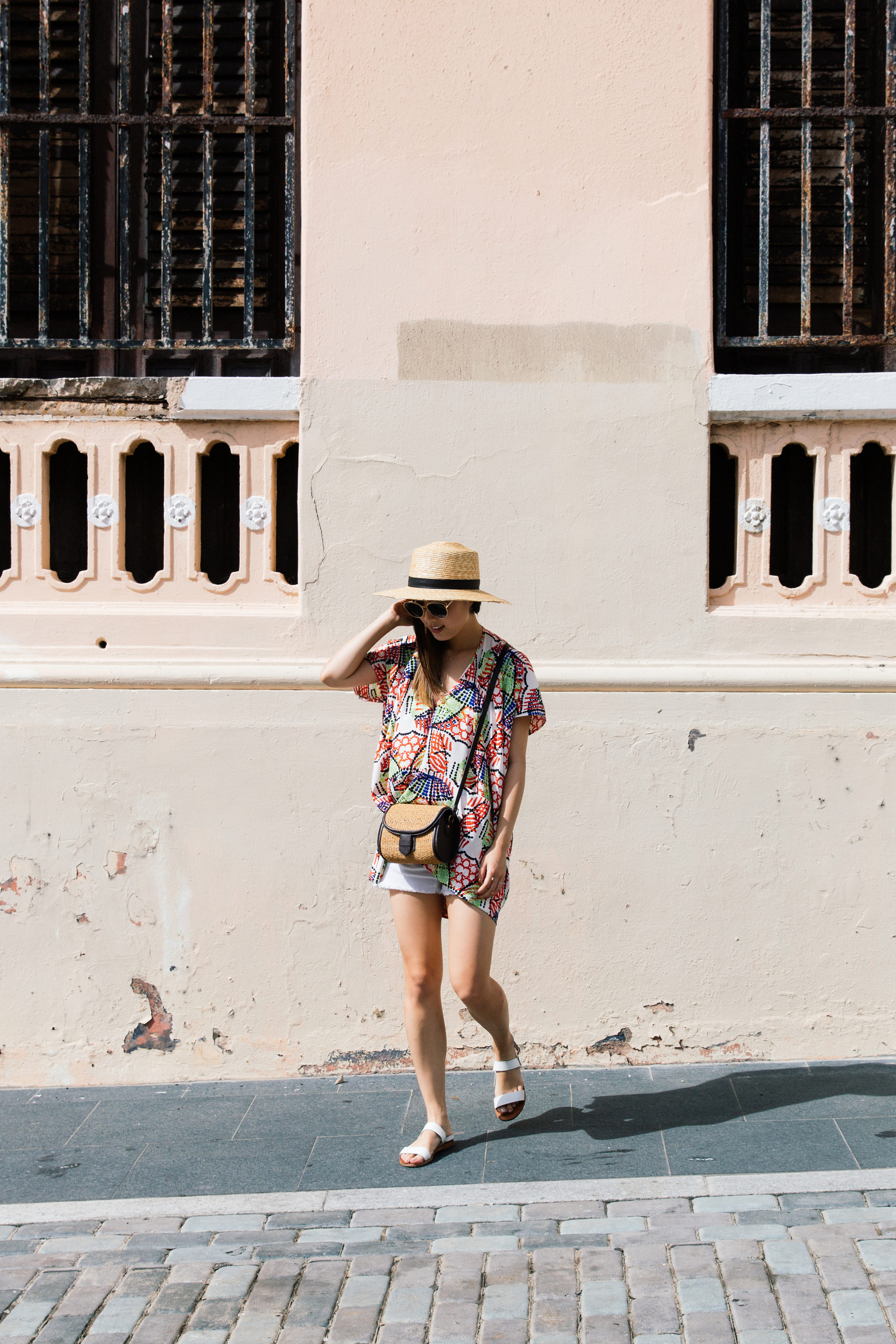 Zero + Maria Cornejo  Top,  Frame Denim Shorts ,  Ancient Greek Sandals , Club Monaco Bag,  Janessa Leone Hat ,  Dior Sunglasses