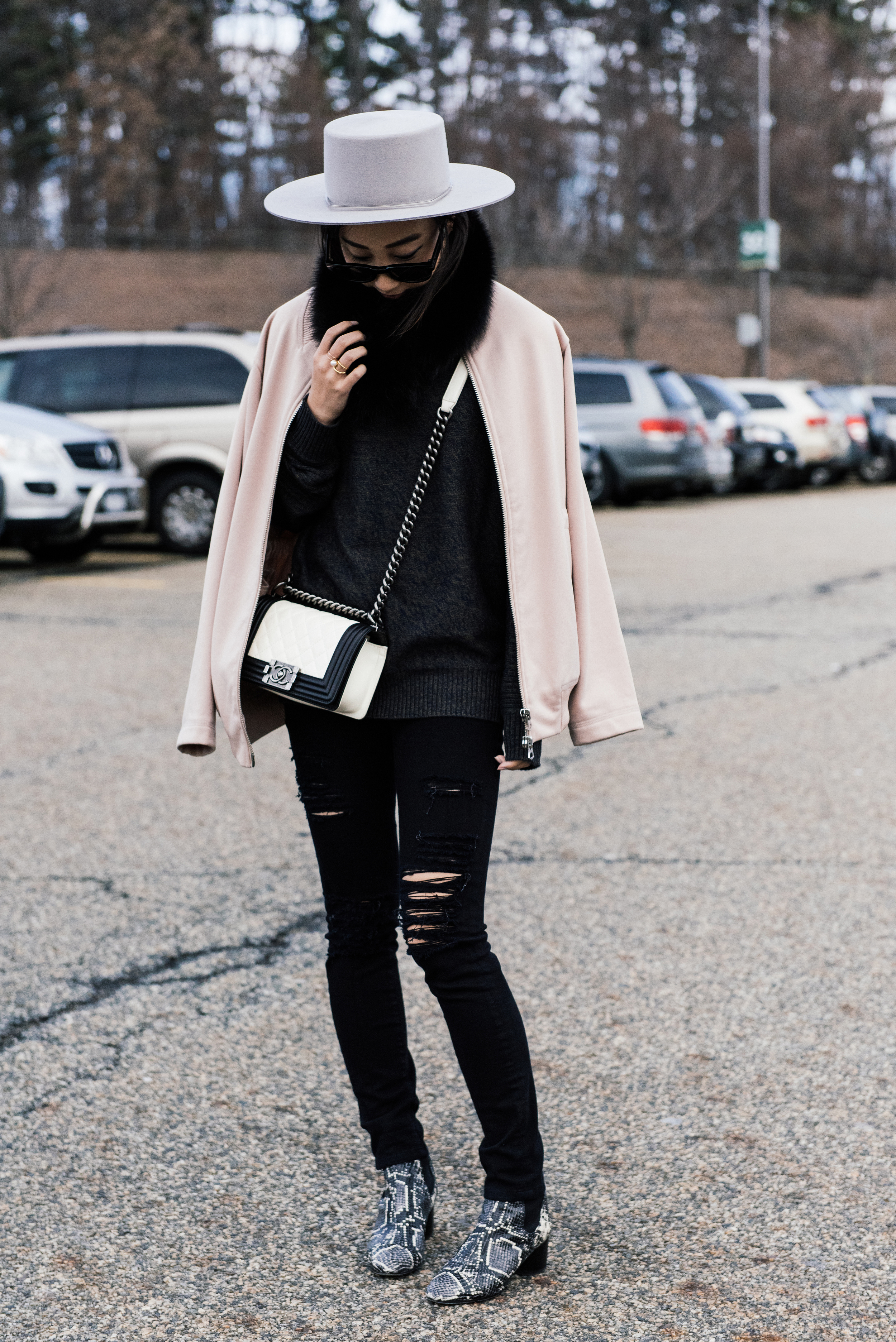Acne Studios Jacket,  Candy and Caviar Sweater ,  Frame Denim , Chanel Bag,  Isabel Marant Boots ,  Janessa Leone Hat