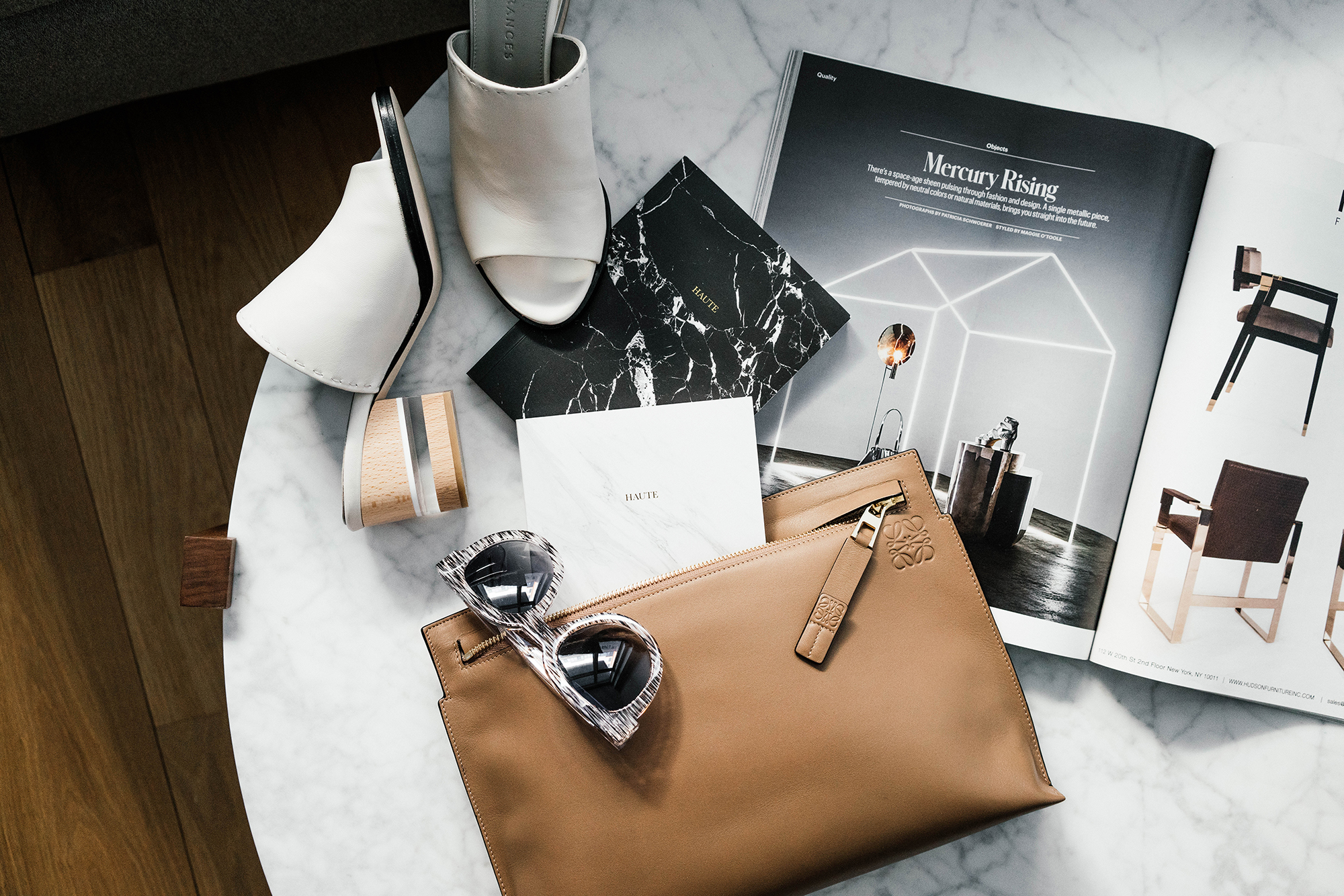 Loewe Clutch ,  Thierry Lasry Sunglasses ,  THP Notebooks ,  Dear Frances Shoes , T Magazine