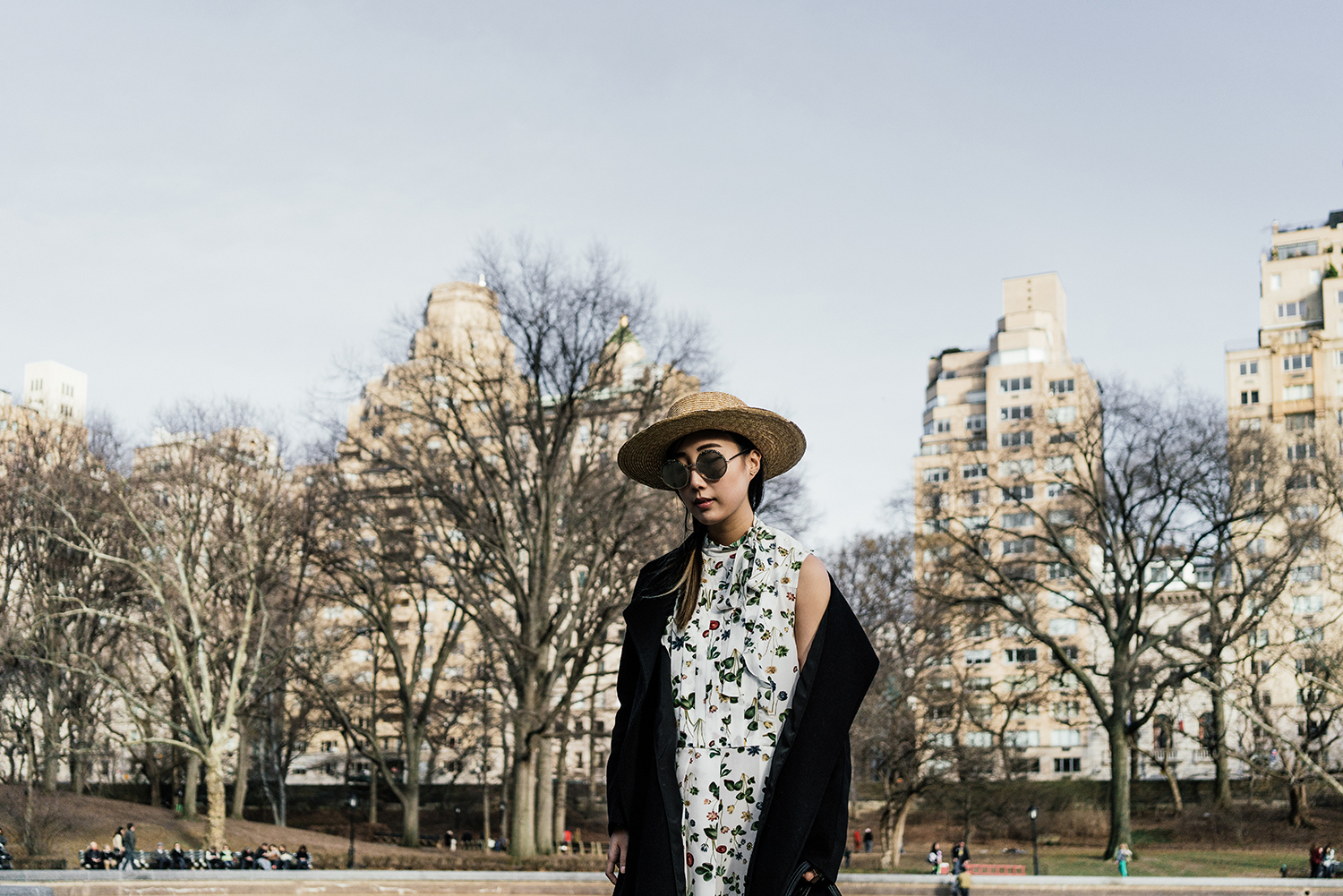 Kuho Coat,  Cacharel Dress ,  Chloe Bag , Givenchy Sandals ( Black ),  Janessa Leone Hat ,  Cutler and Gross Sunglasses