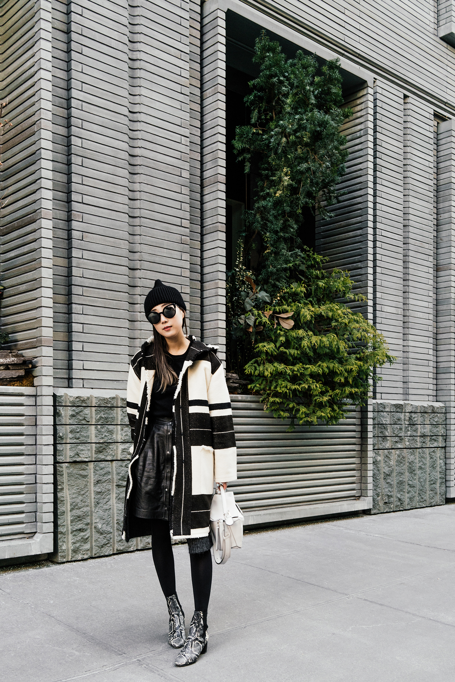 Isabel Marant Coat and  Shoes ,  Everlane Sweater ,  Vince Skirt ,  Loewe Bag ,  Fendi Sunglasses