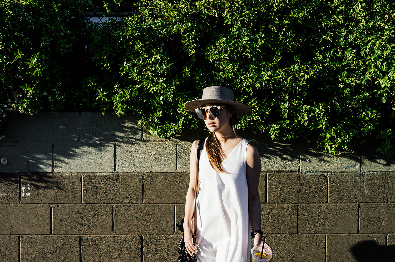 Harvey Faircloth Dress , Céline Sandals,  Janessa Leone Hat ,  Loewe Bag ,  Gentle Monster Sunglasses ,  Larsson & Jennings Watch