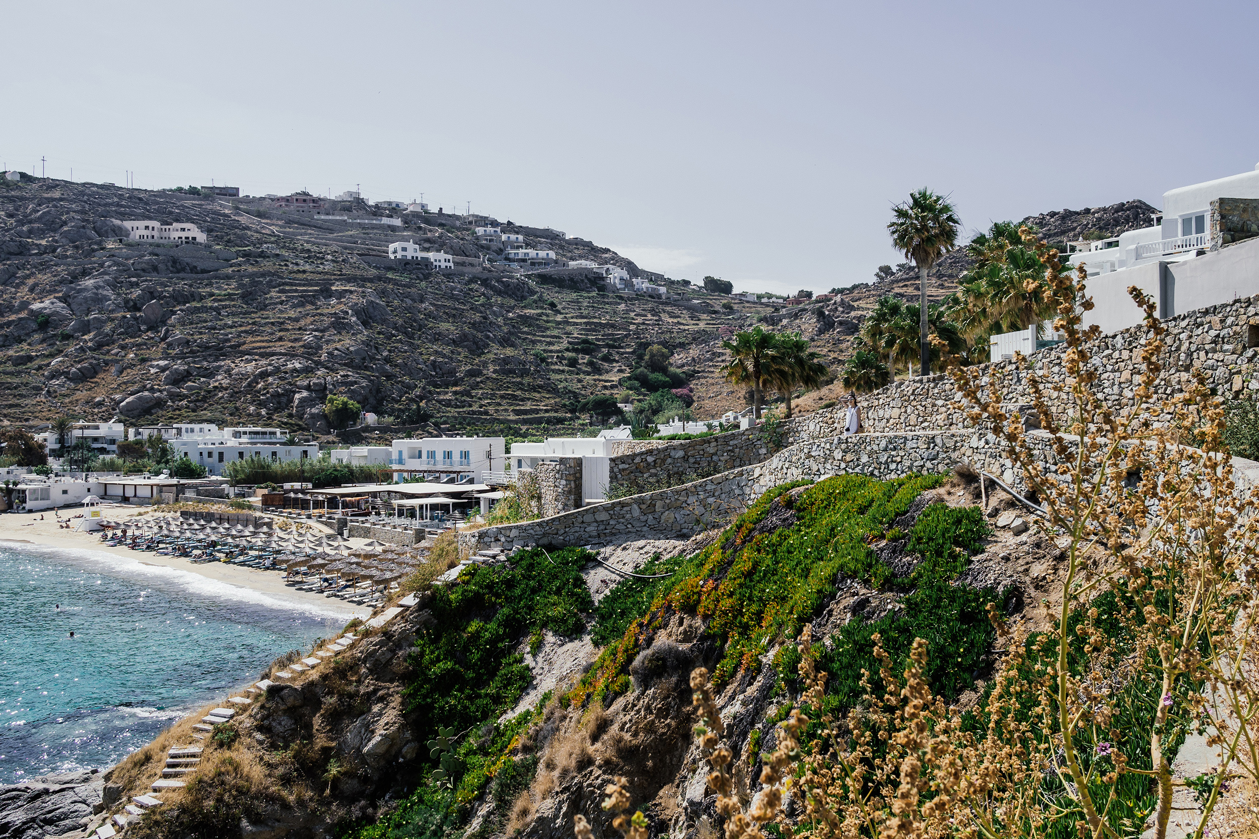 Taking the shortcut to Psarou Beach from our hotel