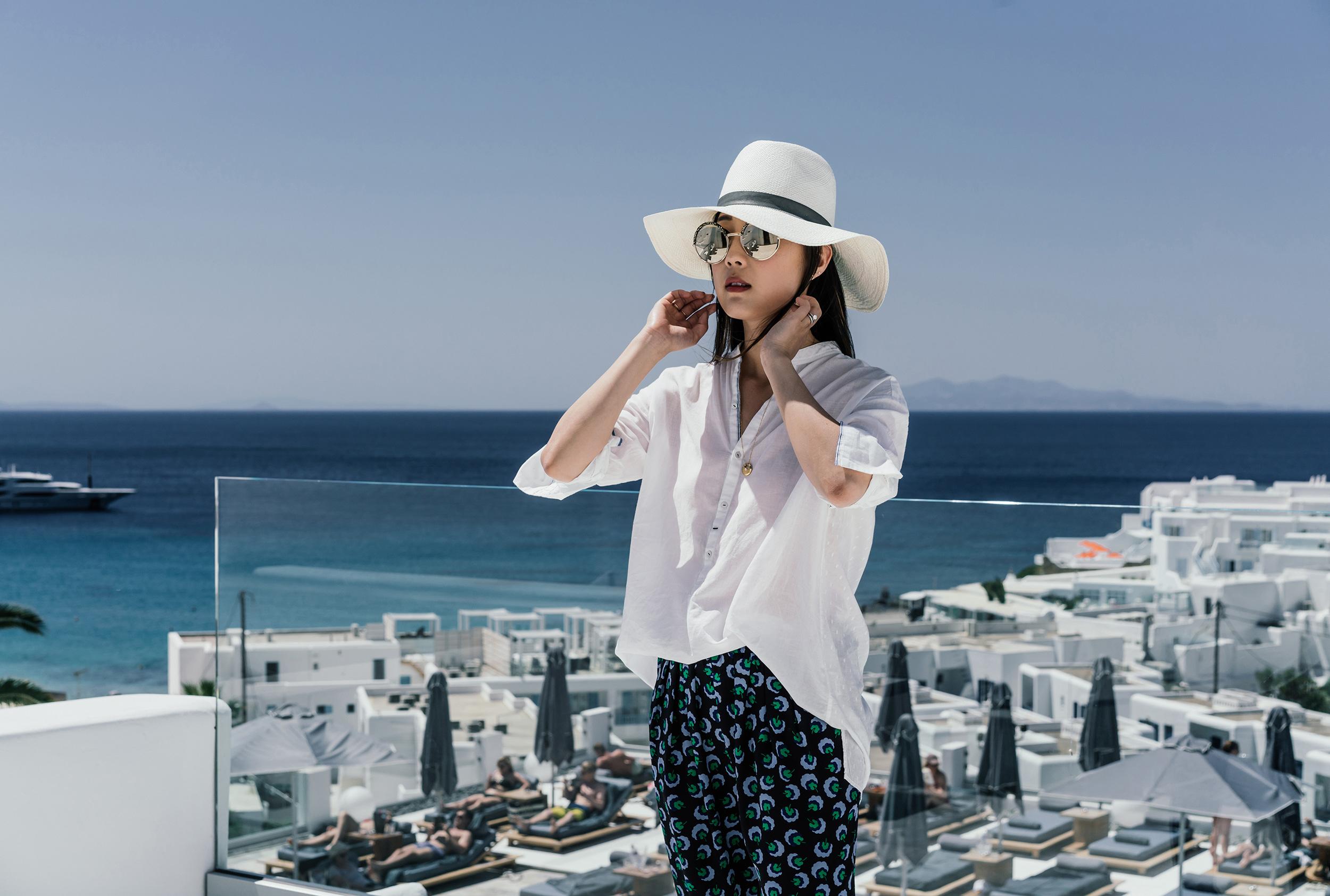 Pas de Calais Top , Stella McCartney Pants,  Vince Shoes ,  Janessa Leone Hat ,  Cutler and Gross Sunglasses ,  Cartier Necklace
