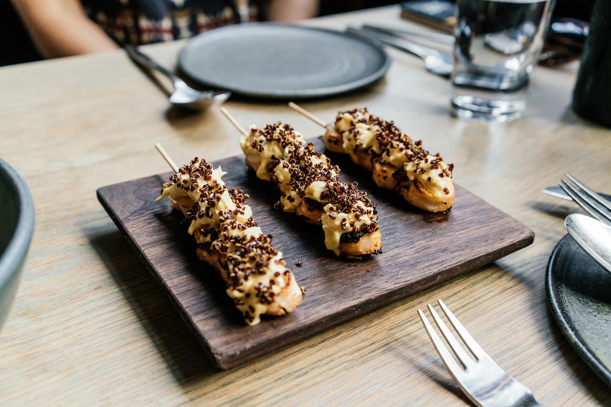 Dinner (shown here: octopus skewers) at  Llama Inn