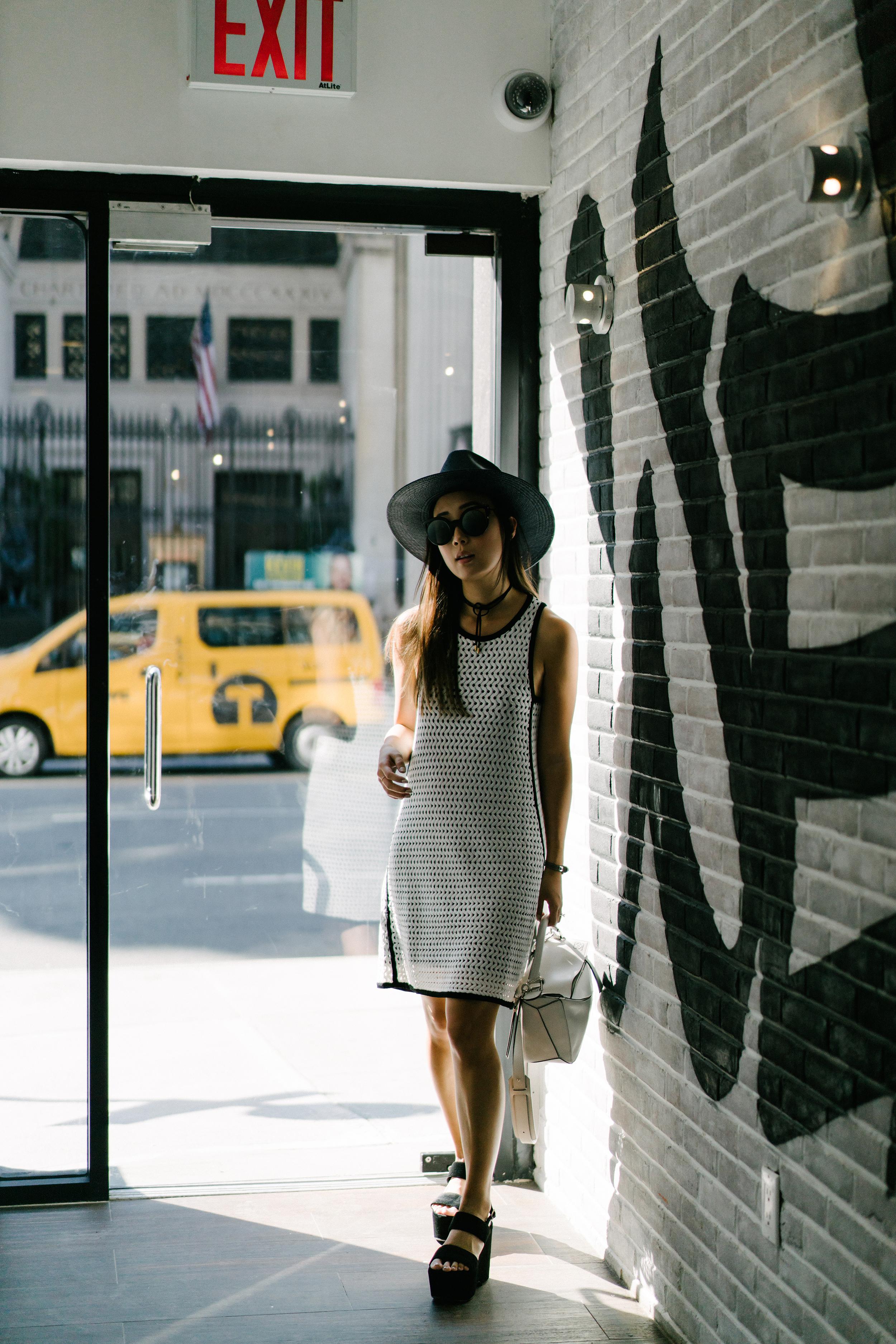Ph5 Dress ,  Loewe Bag , Saint Laurent Shoes, Fendi Sunglasses,  Janessa Leone Hat