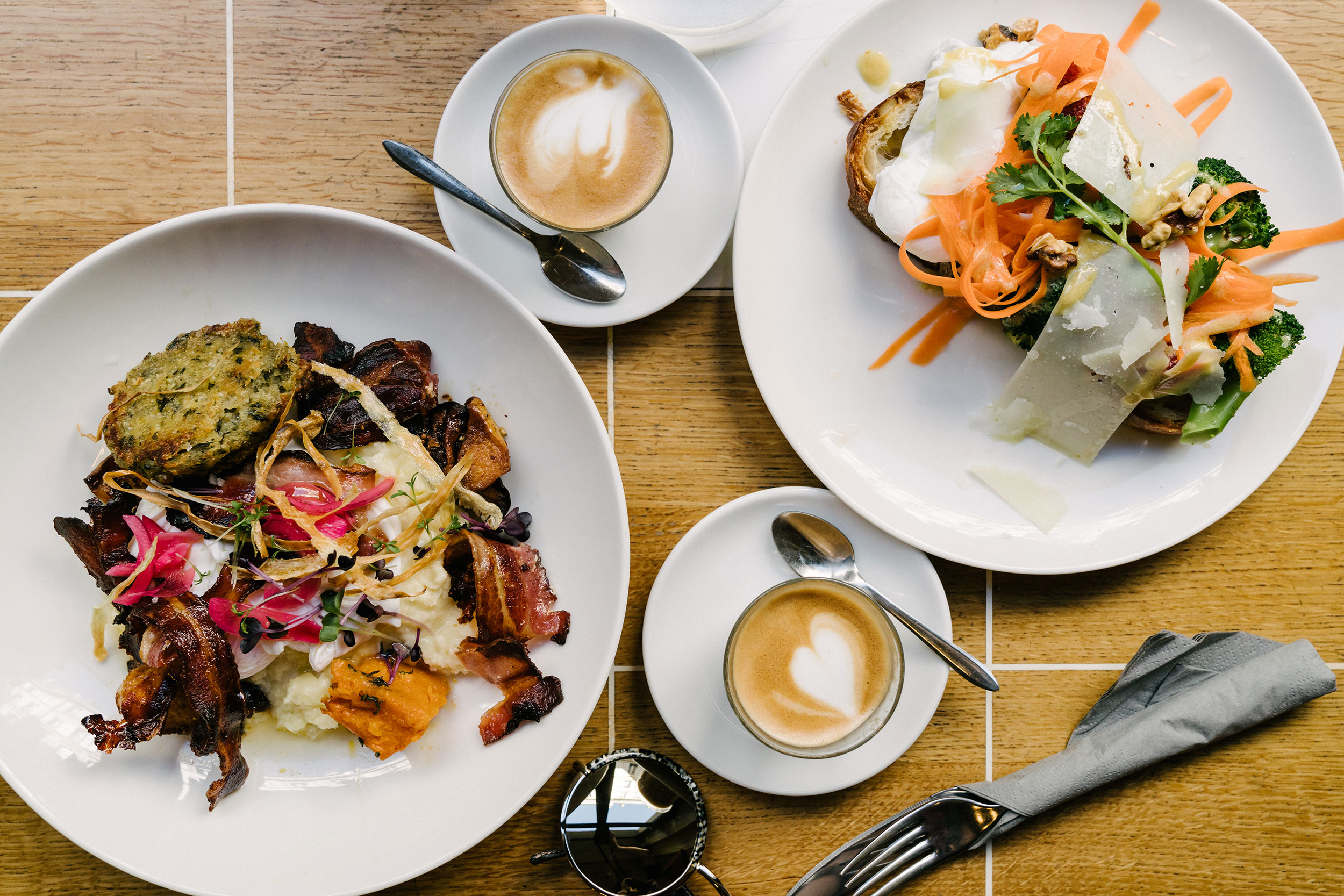 Seasonal brunch plates and cortados at  Coutume Café