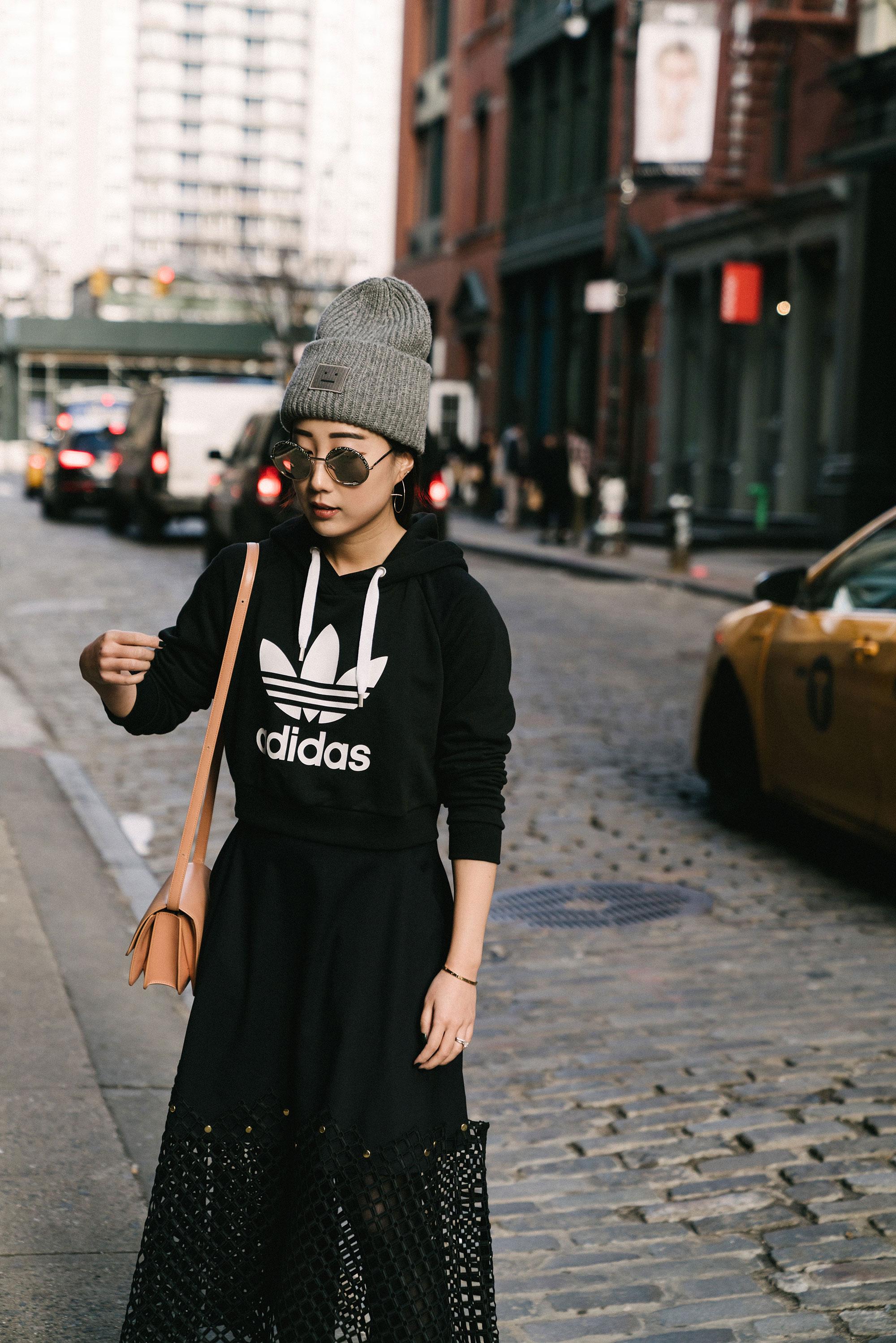 adidas Top , Kolor Skirt,  Céline Bag ,  Acne Studios Hat , Cutler and Gross Sunglasses, Cartier Bracelet,  Hirotaka Earrings