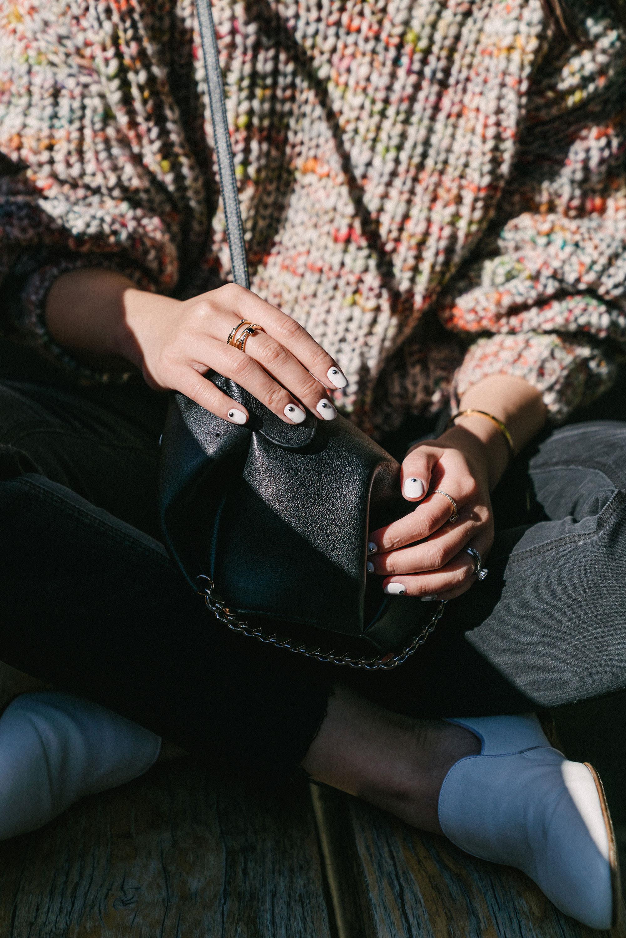 Acne Studios Sweater ,  Grlfrnd Denim ,  The Row Shoes ,  Loewe Bag ,  Janessa Leone Hat ,  Kat Kim Fine Jewelry Rings
