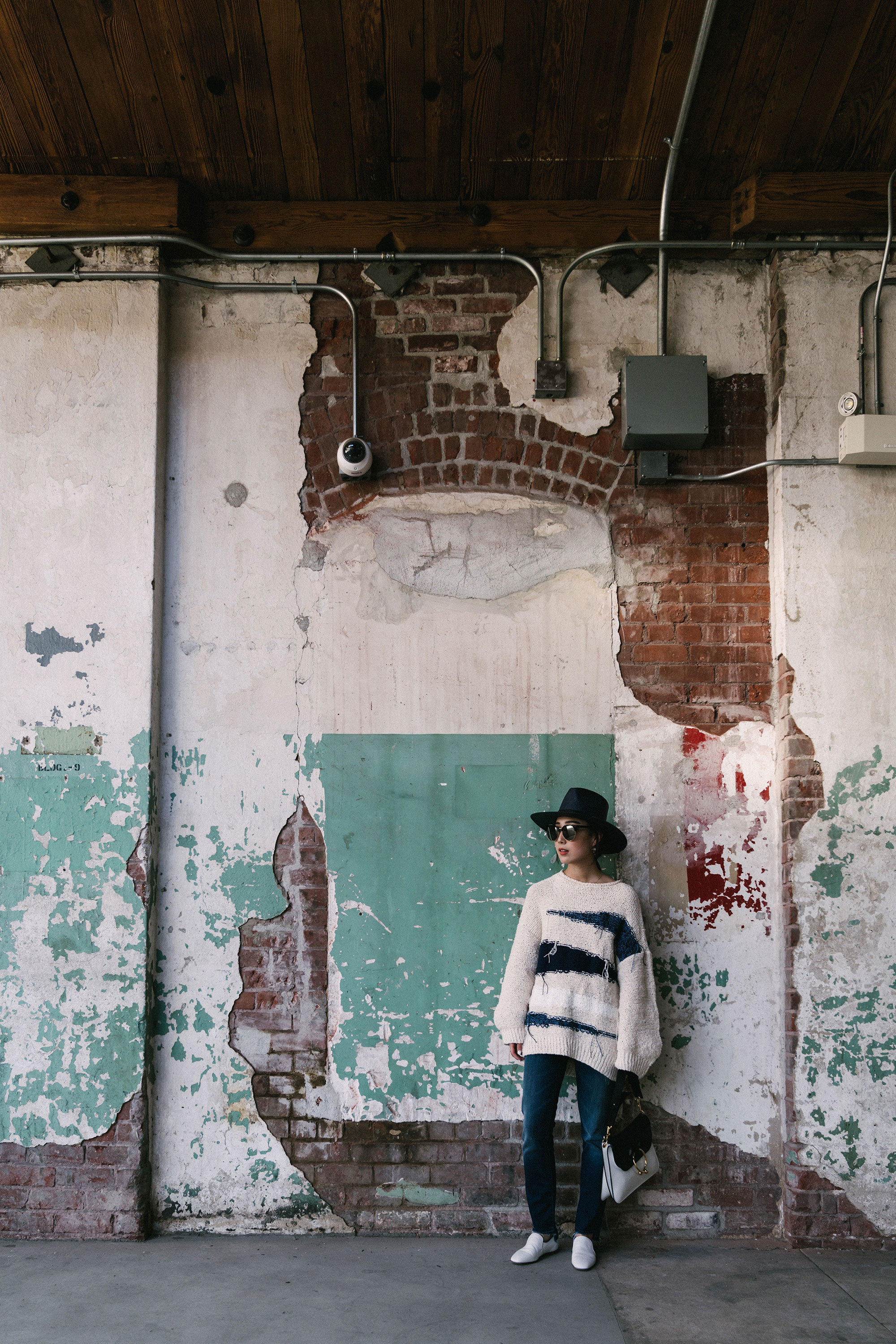 Tomorrowland Sweater ,  Mother Denim ,  The Row Shoes ,  J.W. Anderson Bag ,  Janessa Leone Hat