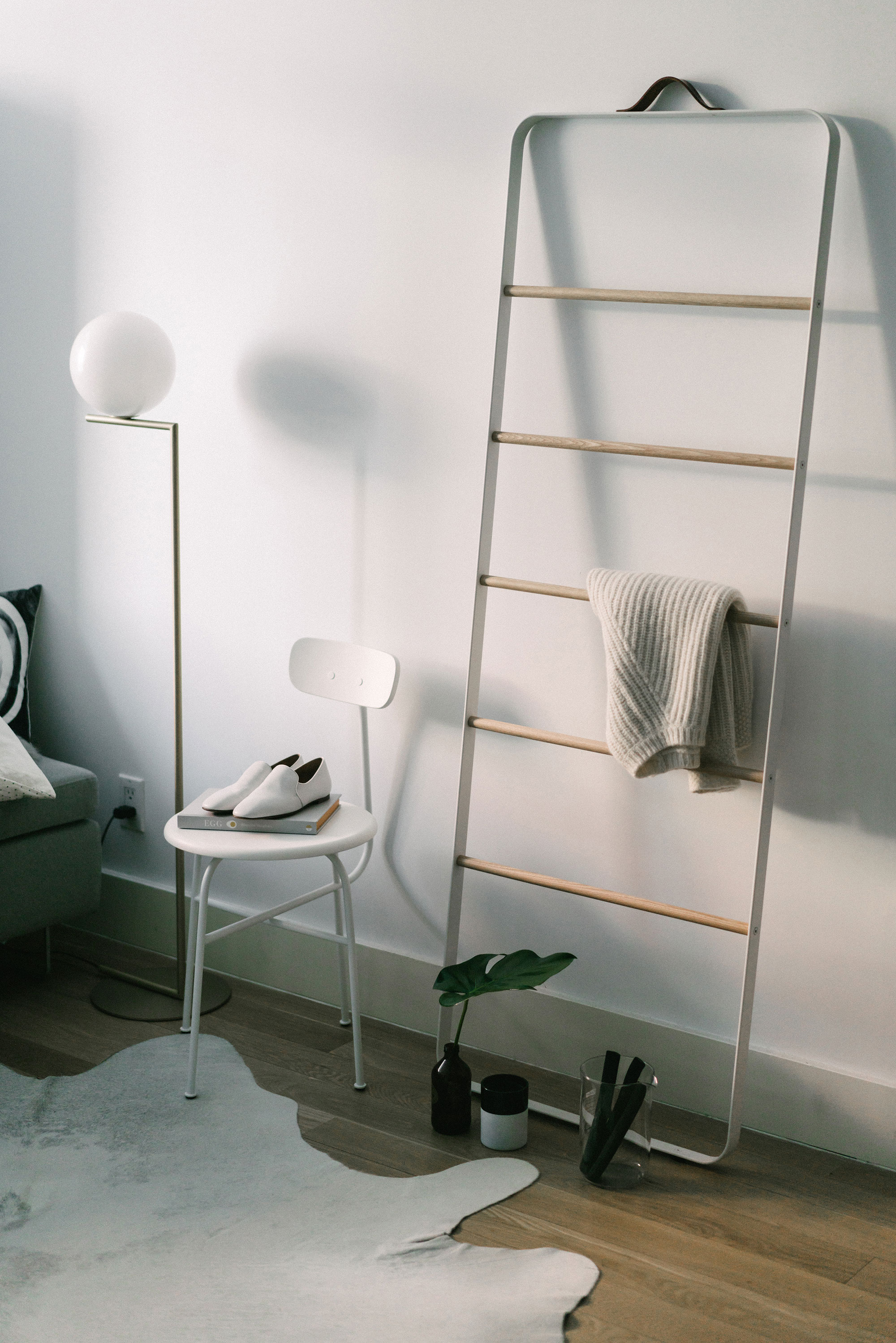 At home –  Flos Lamp ,  Menu Chair  and  Ladder ,  The Row Shoes ,  Nili Lotan Sweater