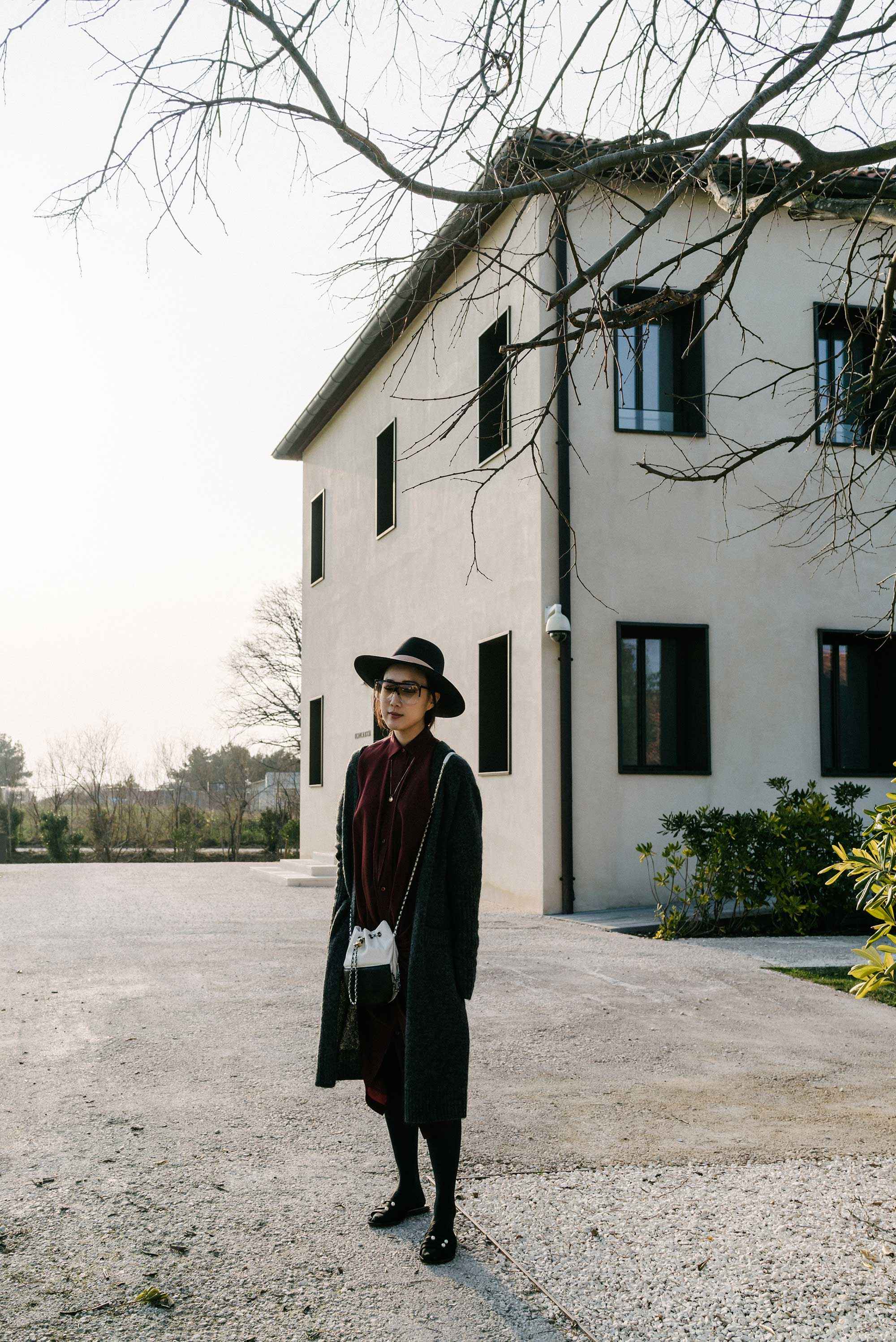 Acne Studios Cardigan,  Sies Marjan Dress , Chanel Bag,  Dear Frances Sandals ,  Loewe Sunglasses ,  Janessa Leone Hat