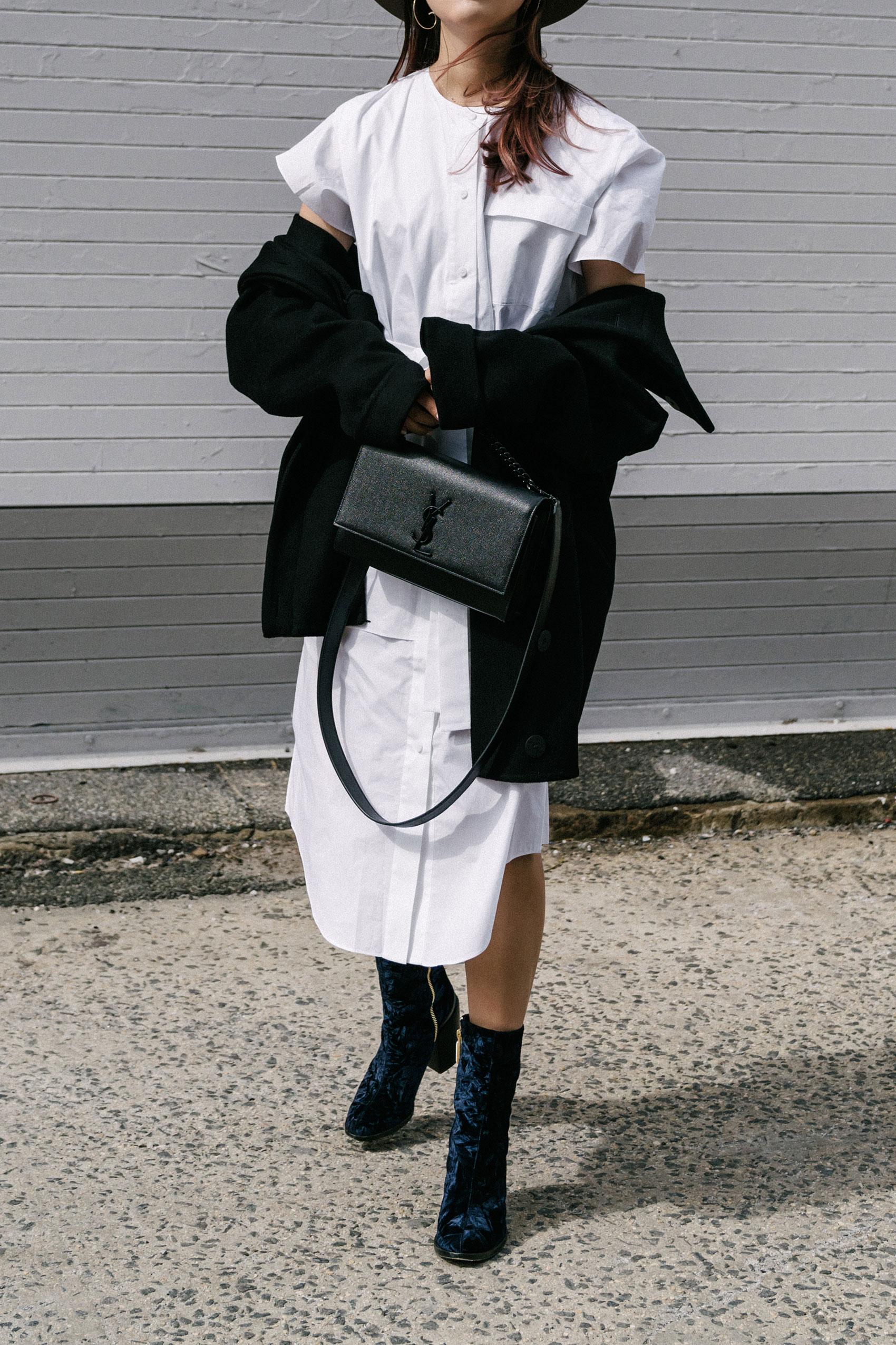 Michelle Waugh Coat ,  COS Dress ,  Dear Frances Boots , Saint Laurent Bag,  Janessa Leone Hat , Céline Sunglasses