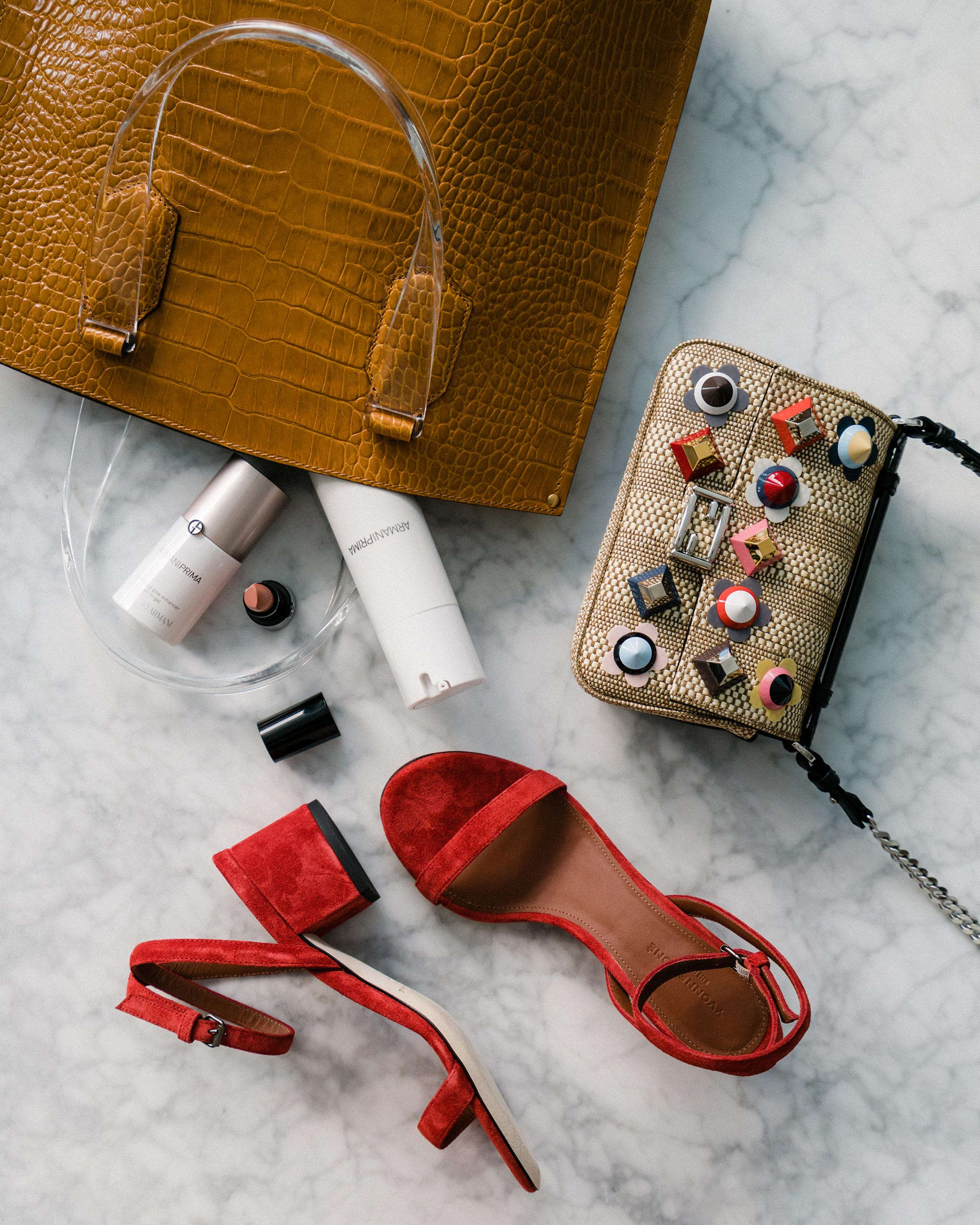 Trademark Bag ,  Armani Beauty Lotion  and  Face Oil ,  Fendi Bag ,  Yvonne Kone Heels