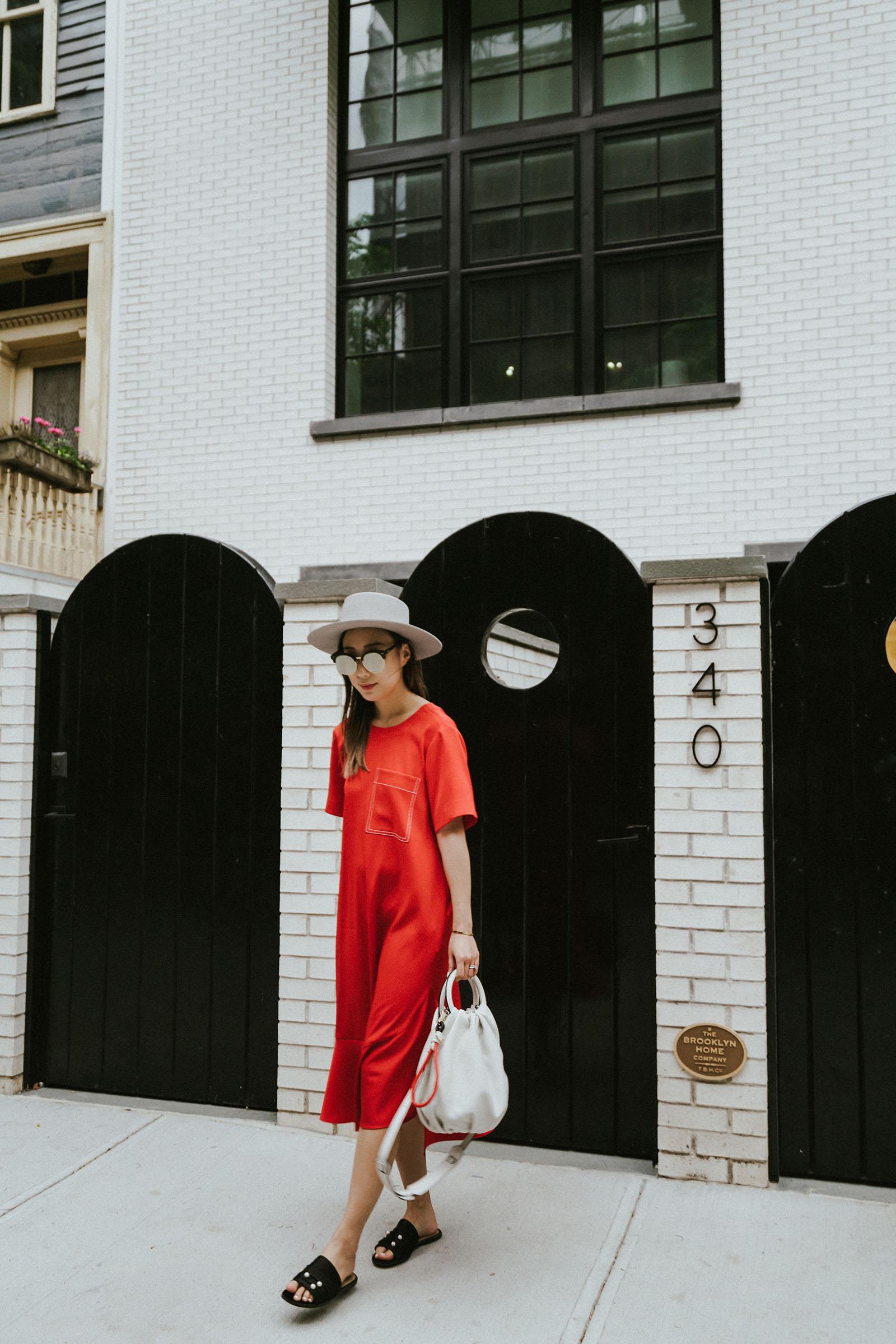 Yune Ho Dress ,  Dear Frances Slides , Loewe Bag,  Janessa Leone Hat