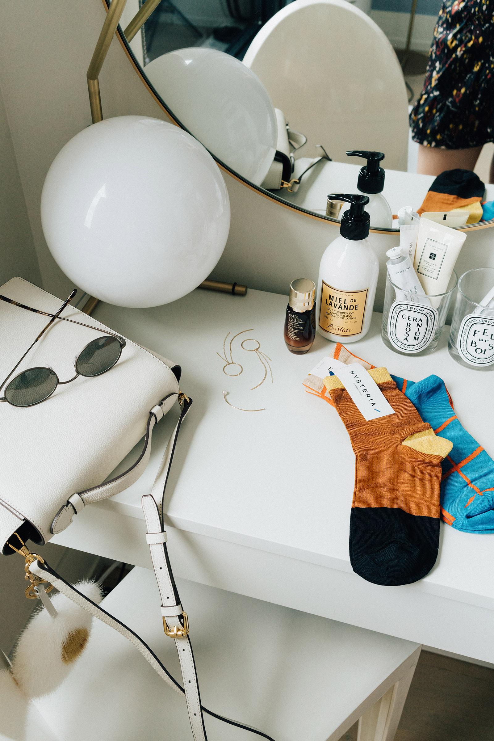Milma Bag ,  Oliver Peoples x The Row Sunglasses ,  Hirotaka Earrings ,  Happy Socks Hysteria Socks ,  Estée Lader Serum ,  Bastide Lotion
