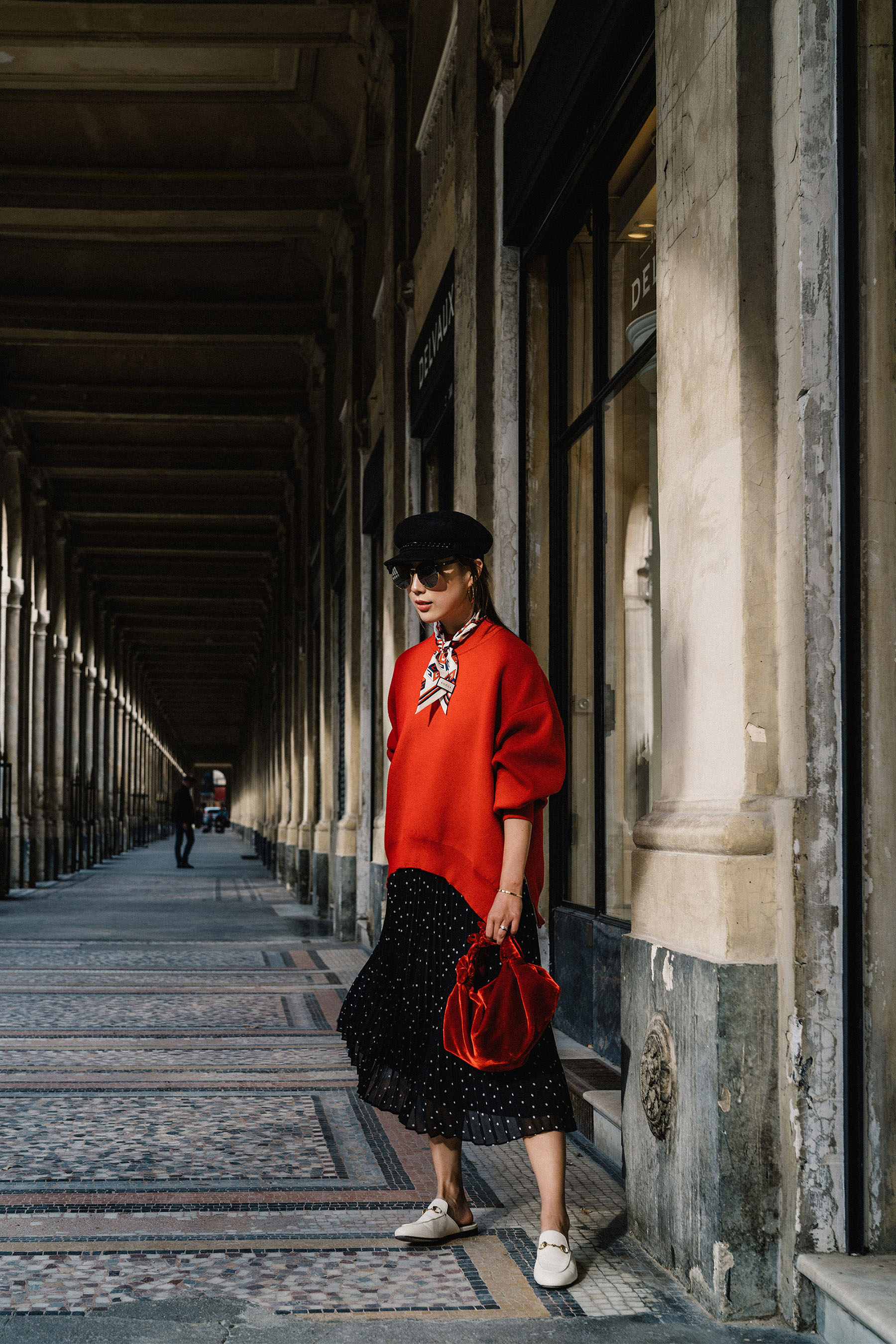 DKNY Pullover ,  Sezane Skirt ,  The Row Bag ,  Gucci Scarf , Eugenia Kim Hat,  Gentle Monster Sunnies ,  Vita Fede Earrings