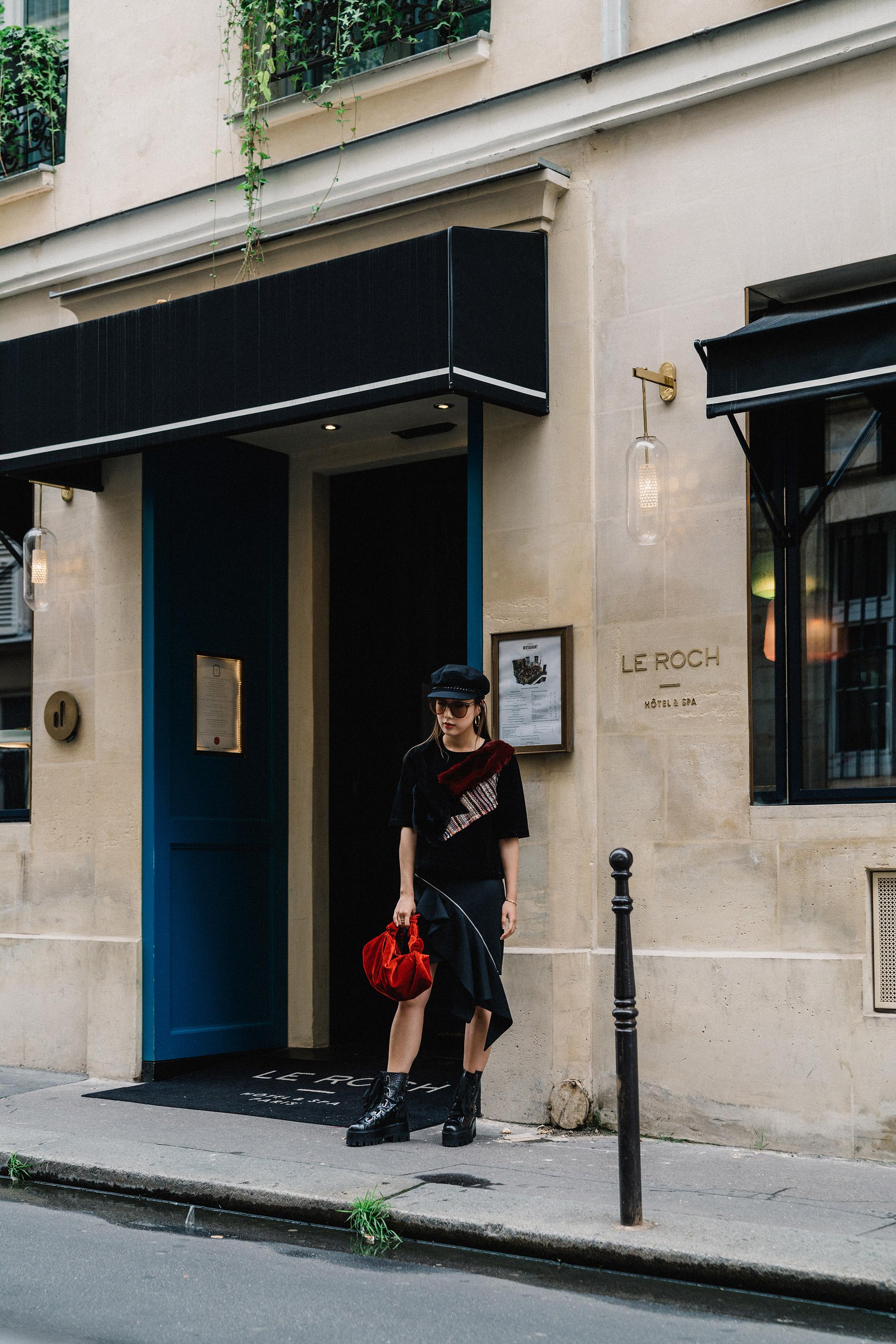 LIE Collection Top , Saint Laurent Skirt, Ellery Boots,  The Row Bag ,  Eugenia Kim Hat ,  Gentle Monster Sunglasses