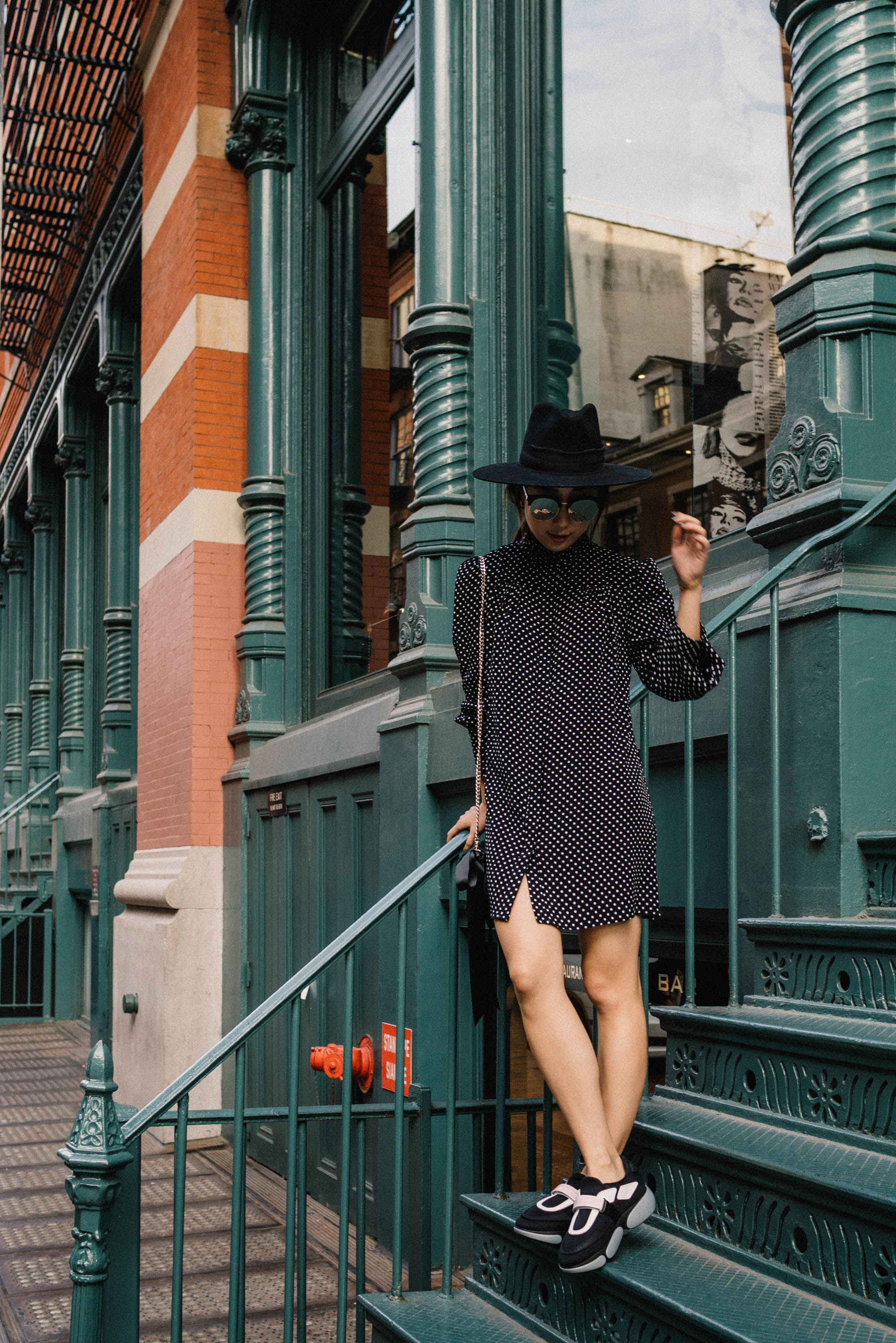 Zara Dress ,  Prada Sneakers ,  J.W. Anderson Bag ,  Janessa Leone Hat