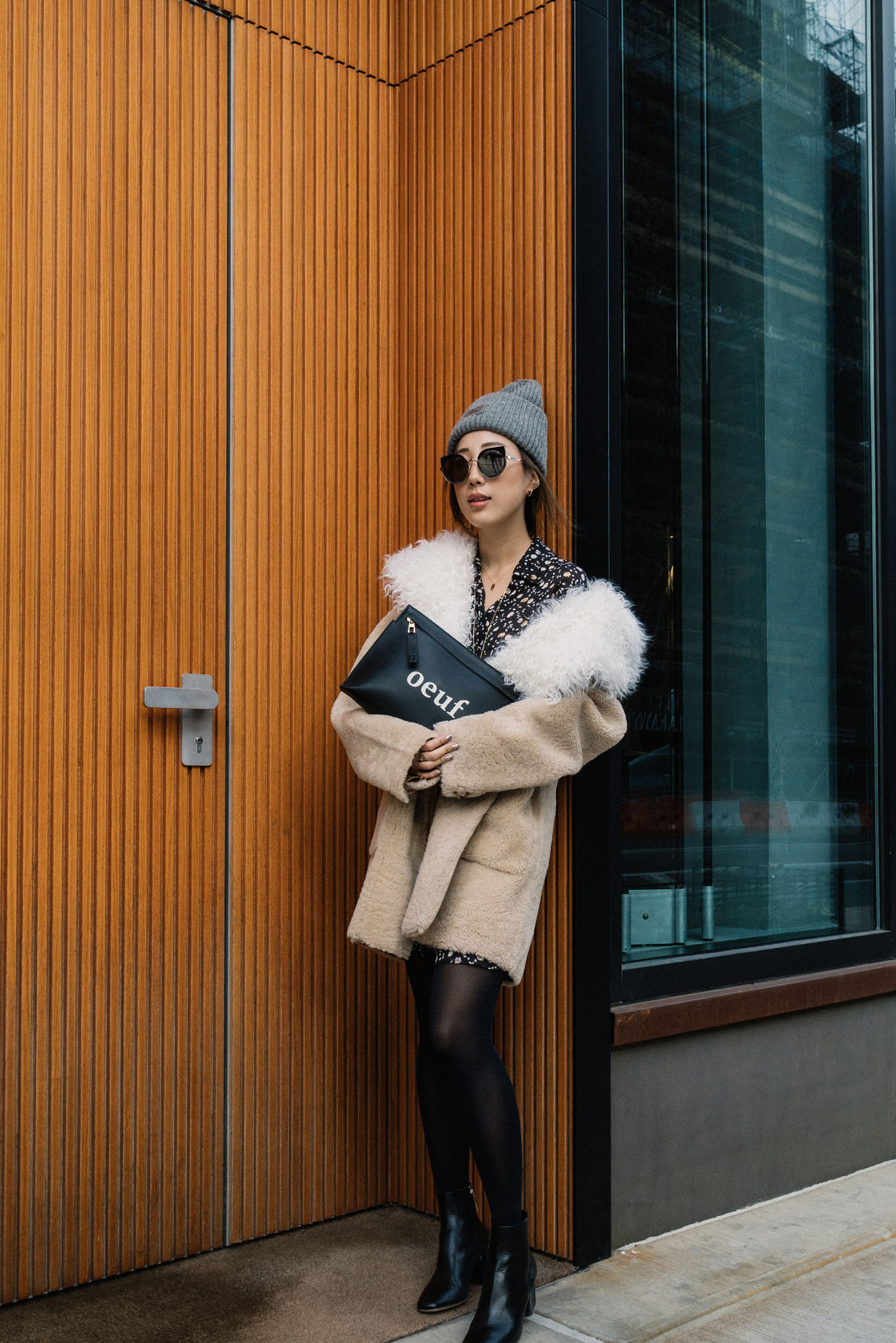 Ulla Johnson Coat ,  Sachin & Babi Dress , The Row Boots, Loewe Clutch,  Gentle Monster x Moooi Sunglasses , Acne Studios Beanie