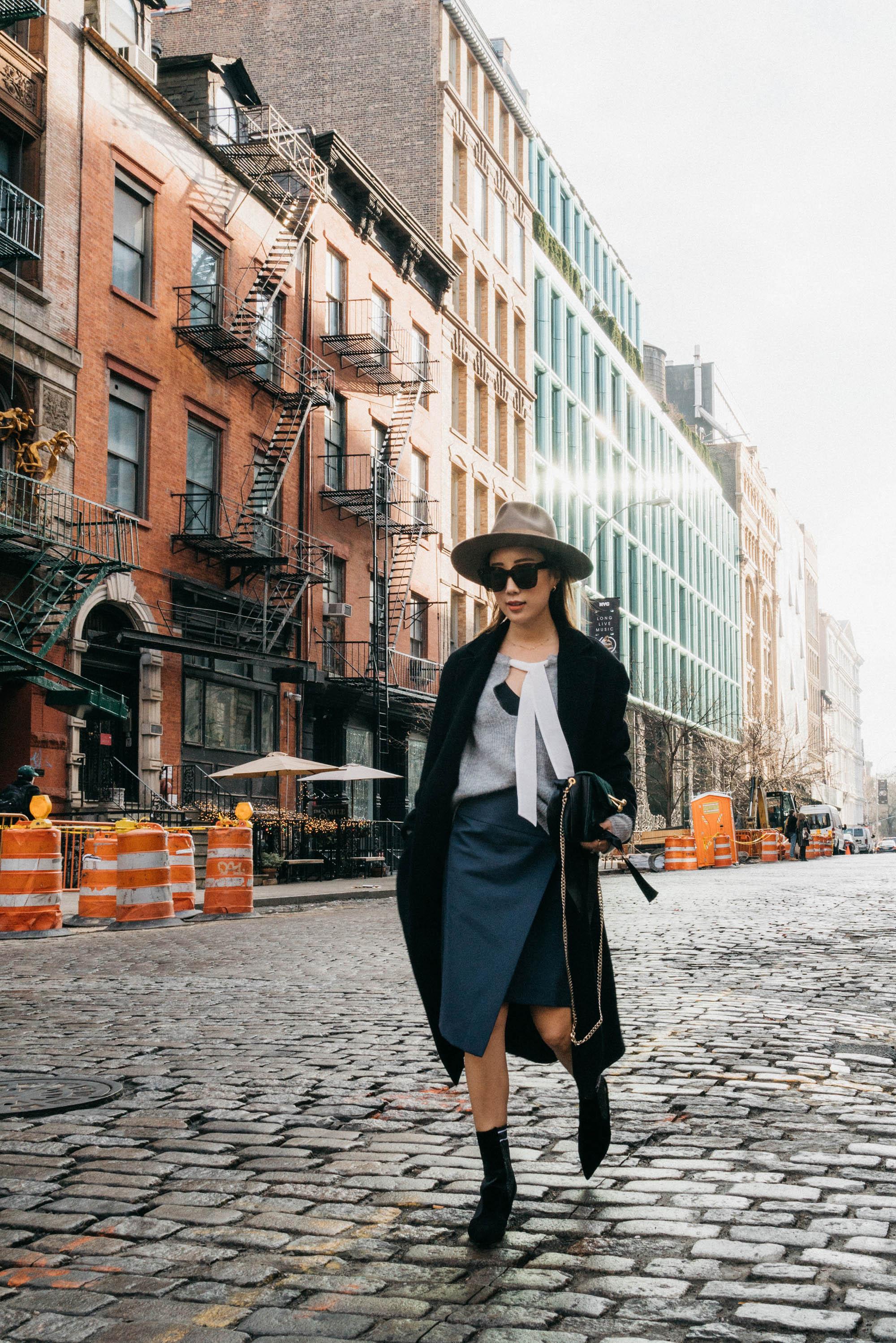 Margaux Lonnberg x Mija Coat ,  Sézane Sweater ,  Voir Lab Skirt ,  Fendi Boots ,  J.W.Anderson Bag ,  Janessa Leone Hat