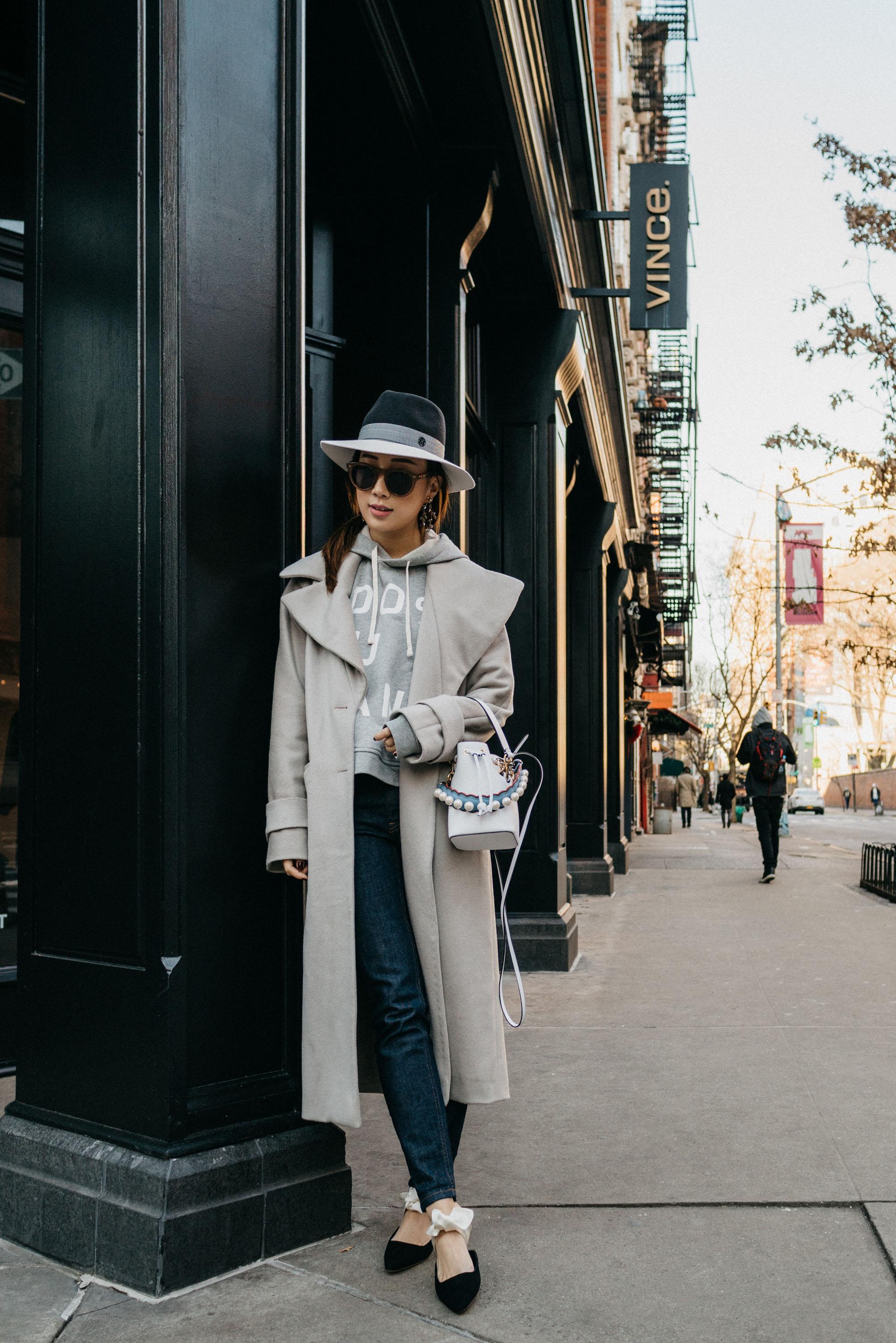 Michelle Waugh Coat ,  Everlane Hoodie ,  Everlane Denim ,  The Row Shoes , Fendi Bag, Maison Michel Hat