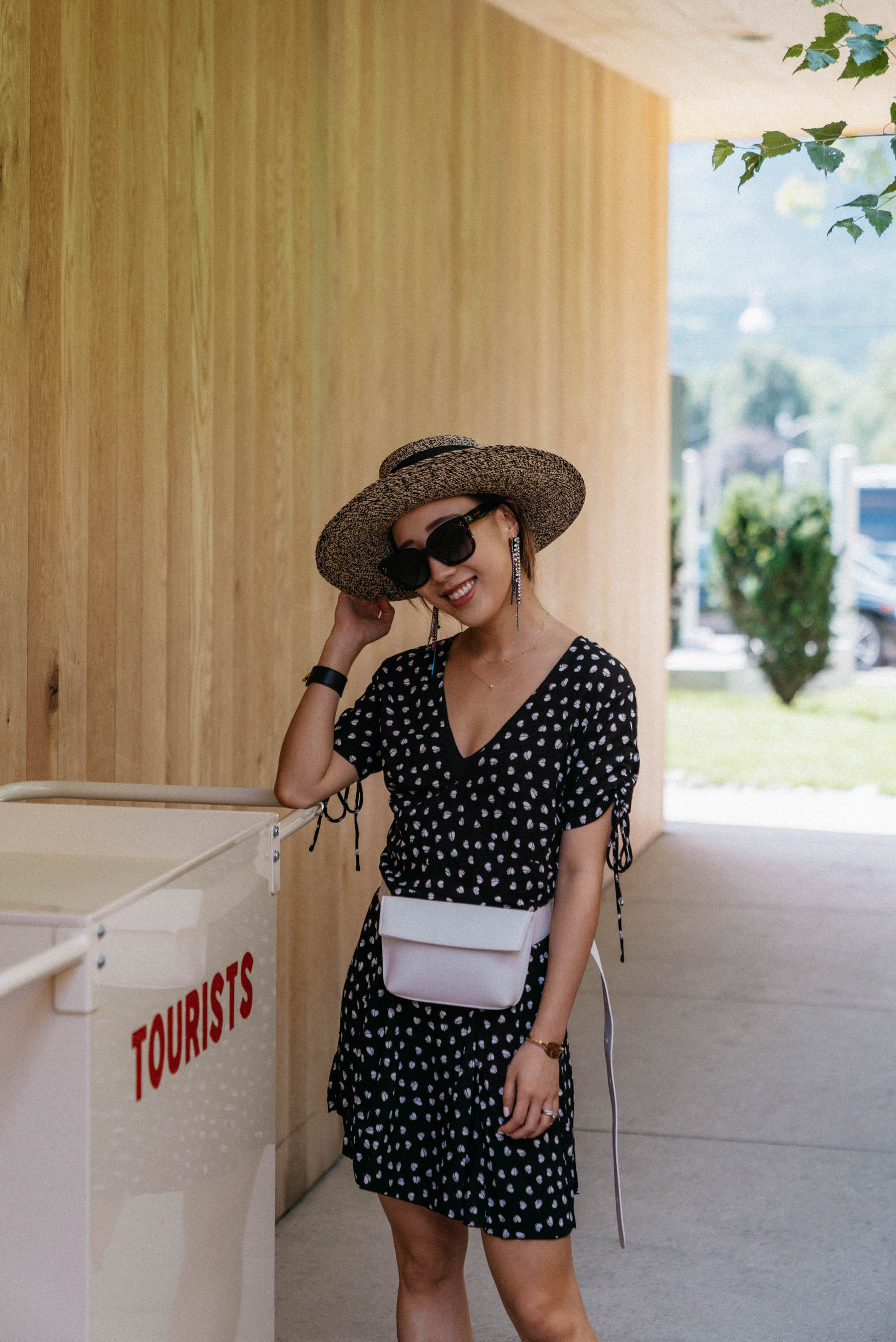 Rue Stiic Dress ,  Golden Goose Sneakers ,  Yvonne Kone Bag , Sensi Studio Hat, Area Earrings