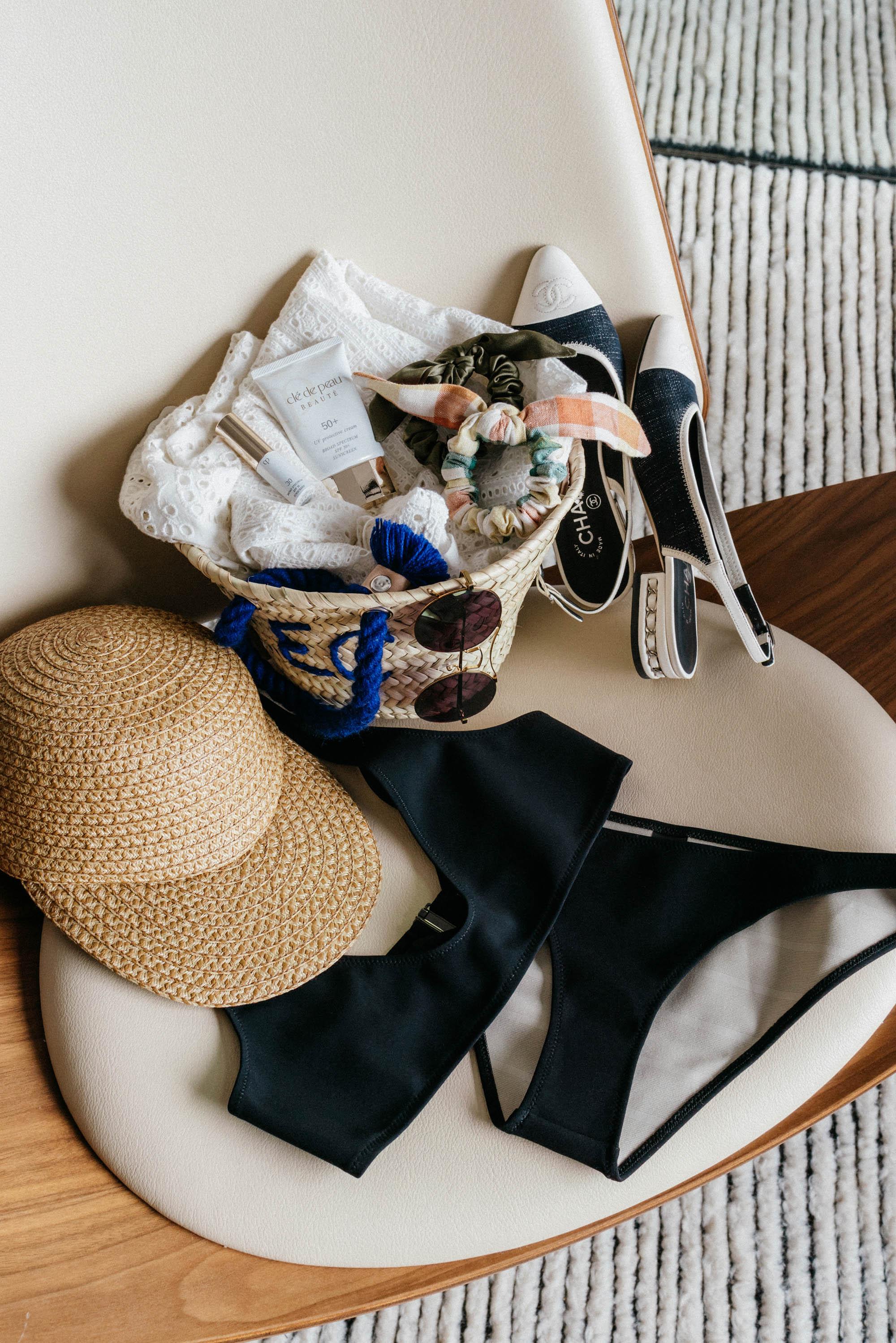 Poolside Bag ,  Clé de Peau Beatué Sunscreen ,  DONNI. Scrunchies , Chanel Shoes,  Eric Javits Hat ,  Rochelle Sara Swim