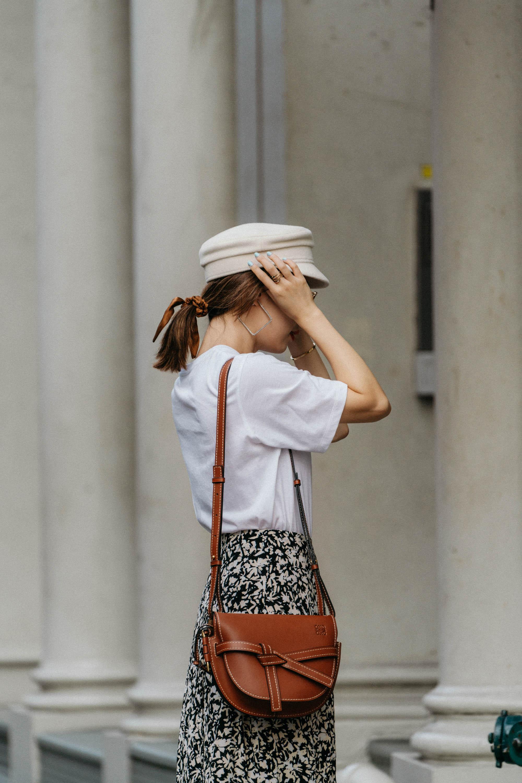 Common Odds Shirt,  Proenza Schouler Skirt,  Loewe Bag ,  Ruslan Baginskiy Hat ,  Donni Scrunchie ,  AREA Earrings