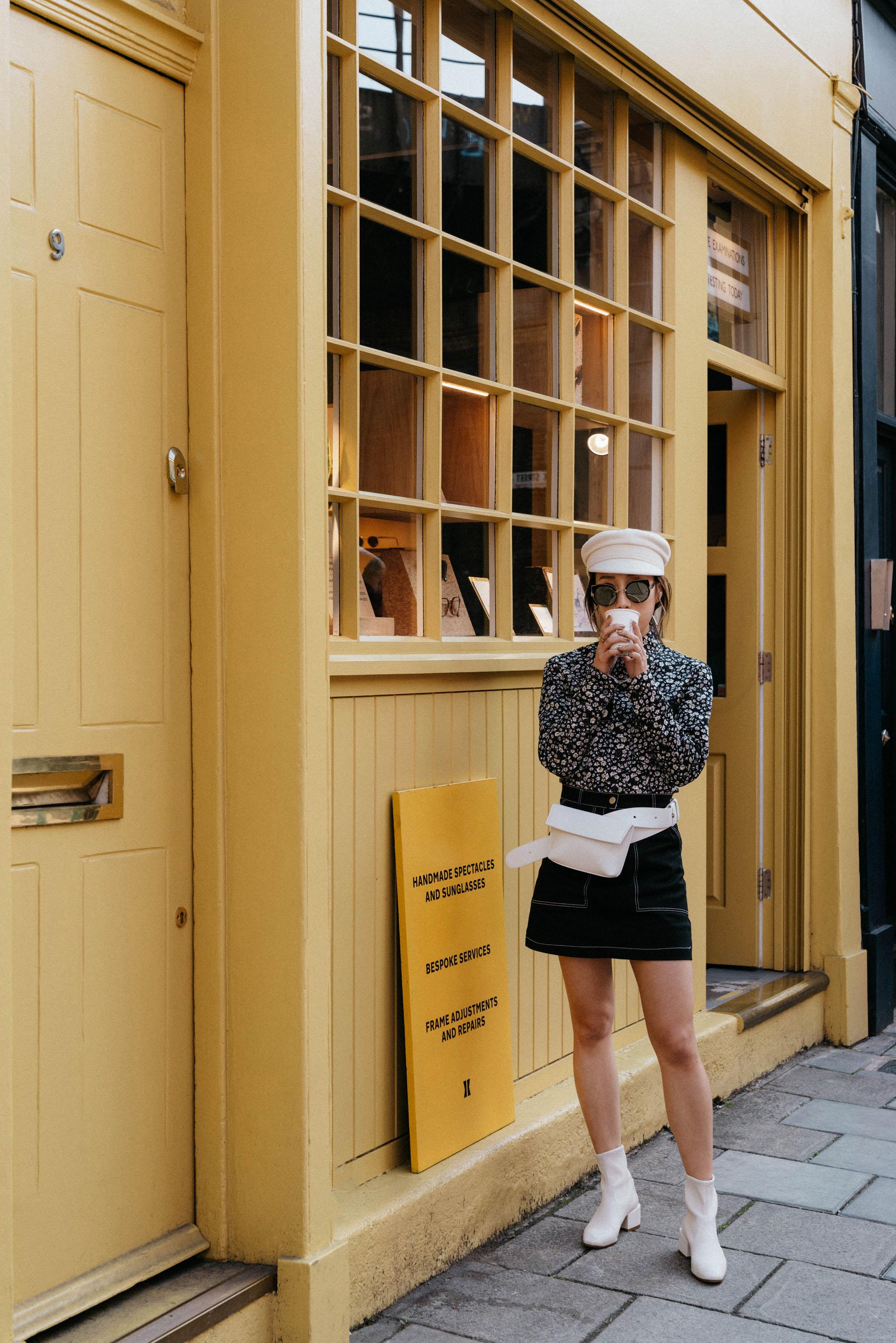 Calvin Klein 205W39NYC Shirt, Aland Skirt,  Yvonne Kone Bag ,  Stuart Weitzmann Boots , Gentle Monster Sunglasses,  Ruslan Baginskiy Hat