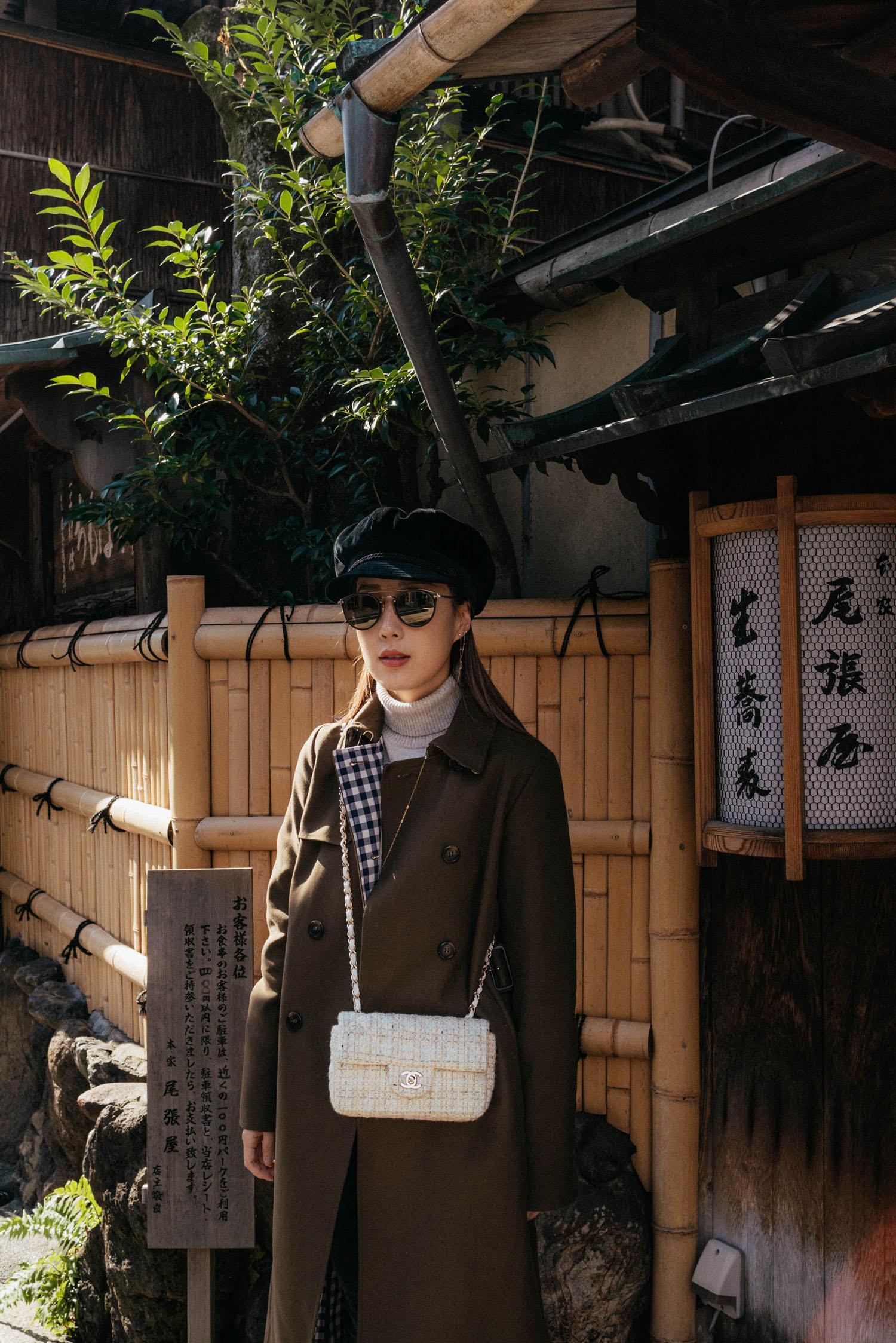 Tara Jarmon Trench ,  Maison Labiche Sweater , Chanel Bag,  Eric Javits Hat , Oliver Peoples Sunglasses