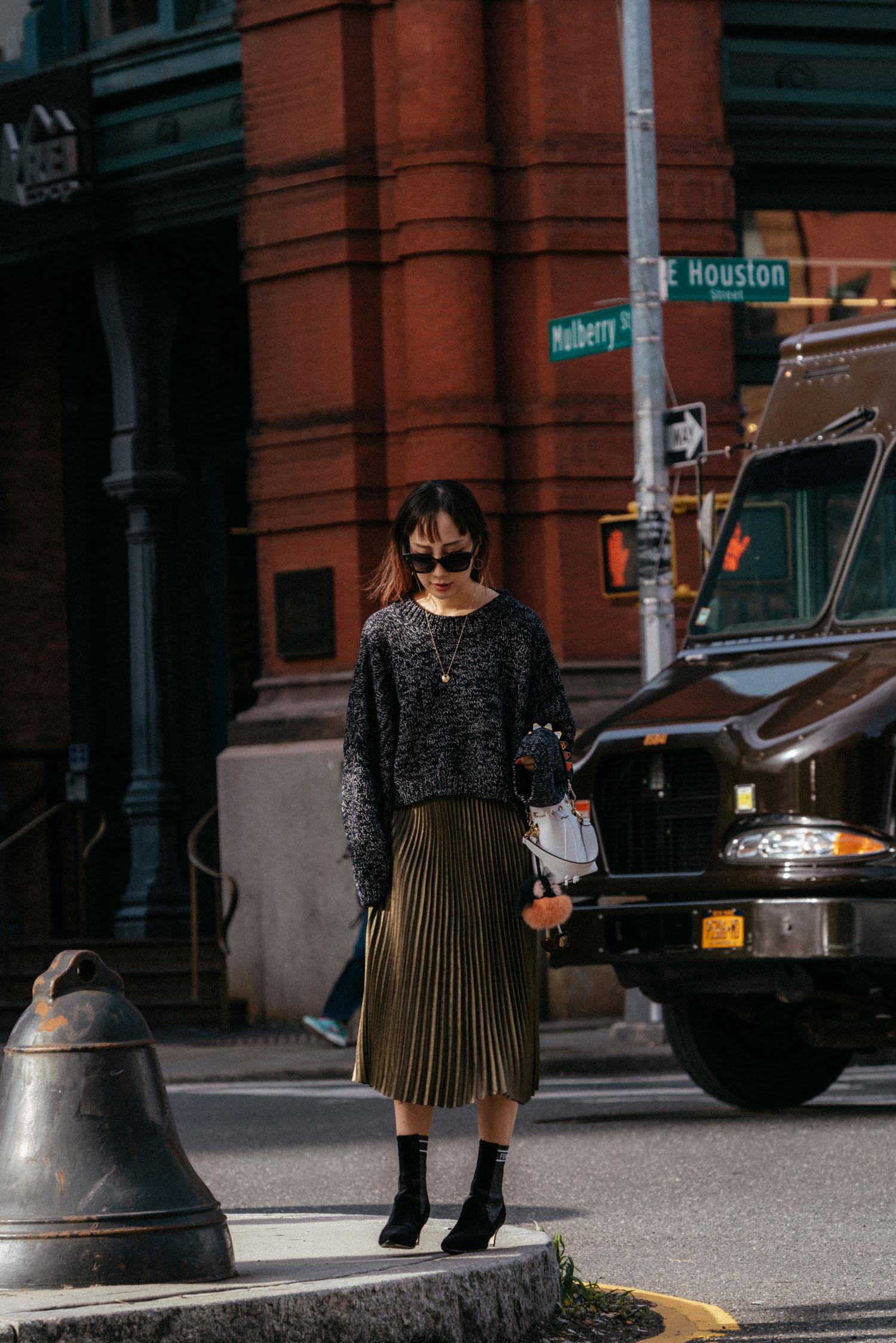 J.W. Anderson Sweater,  Sézane Skirt , Fendi Boots,  Fendi Bag ,  Hirotaka Earrings ,  Cartier Necklace