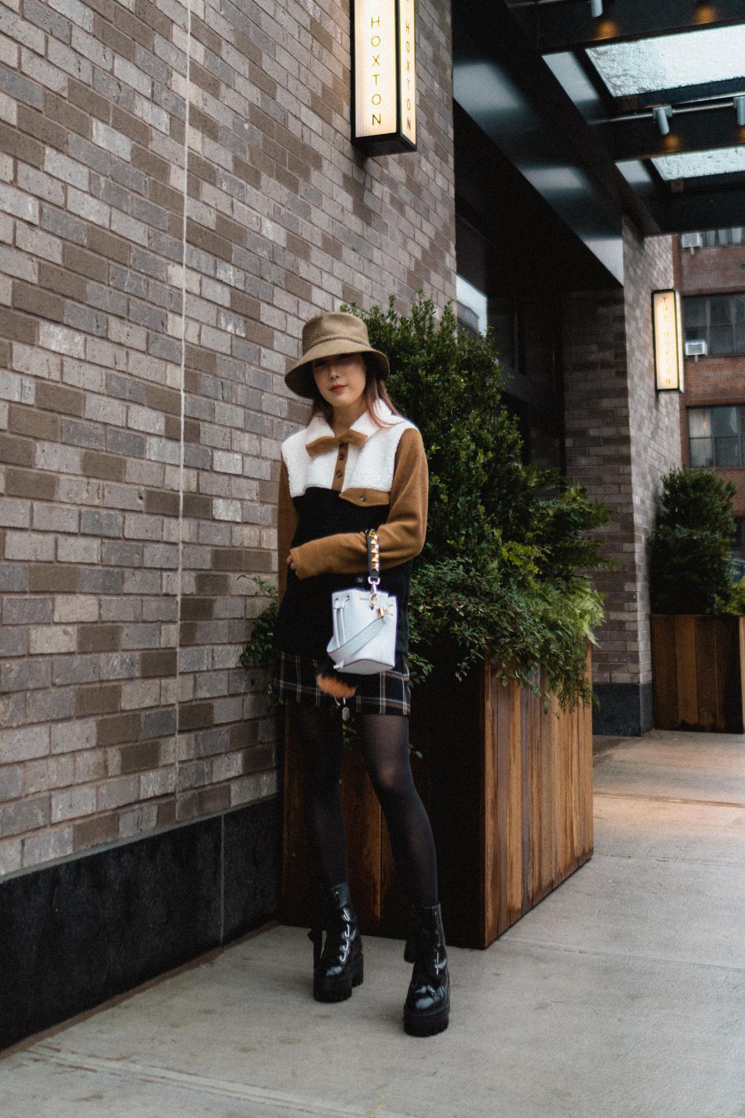 Donni Sweater , Reformation Skirt, Ellery Boots,  Fendi Bag ,  Eric Javits Hat