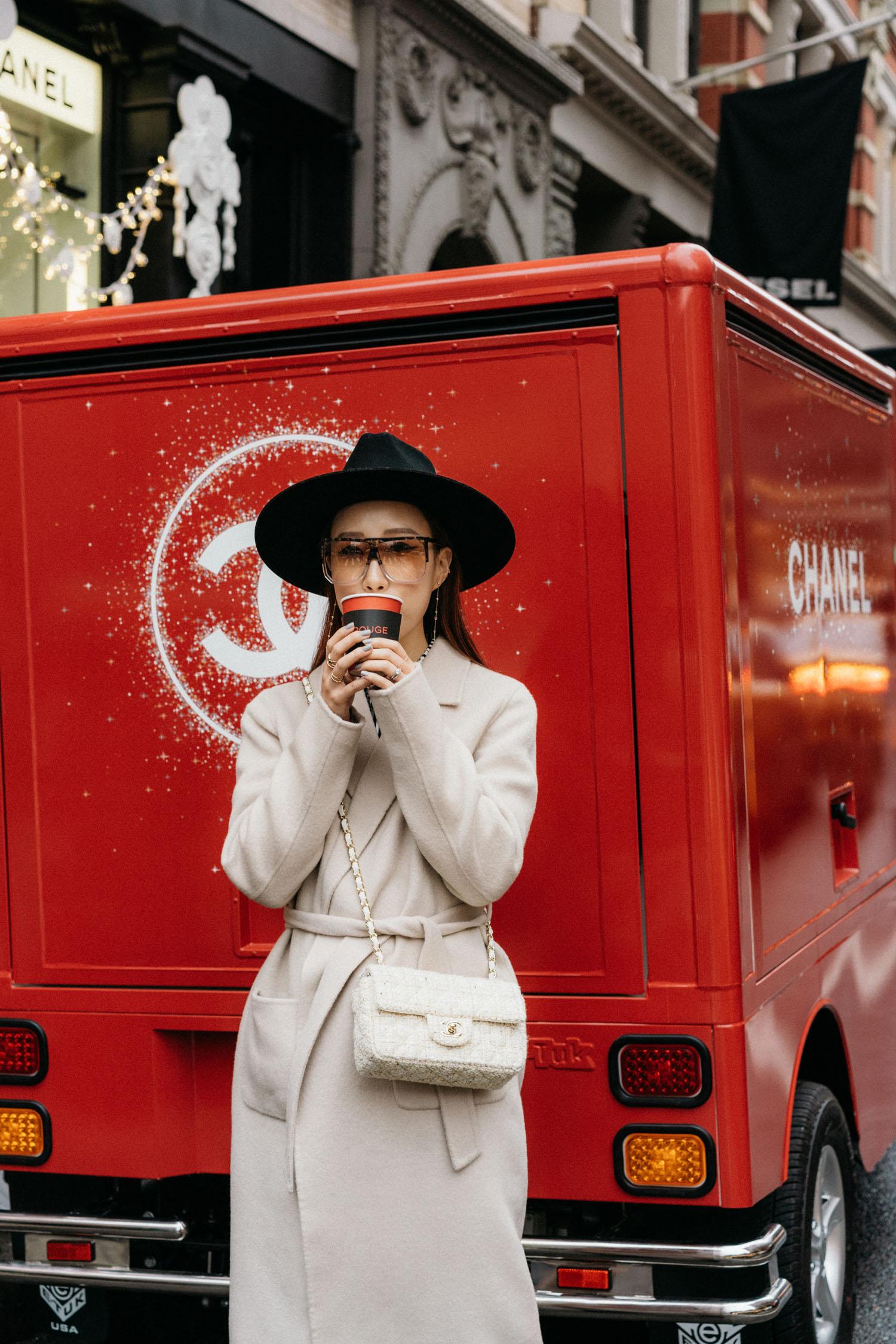 Sézane Coat , Altuzarra Dress,  Pierre Hardy Boots ,  Chanel Bag ,  Loewe Sunglasses