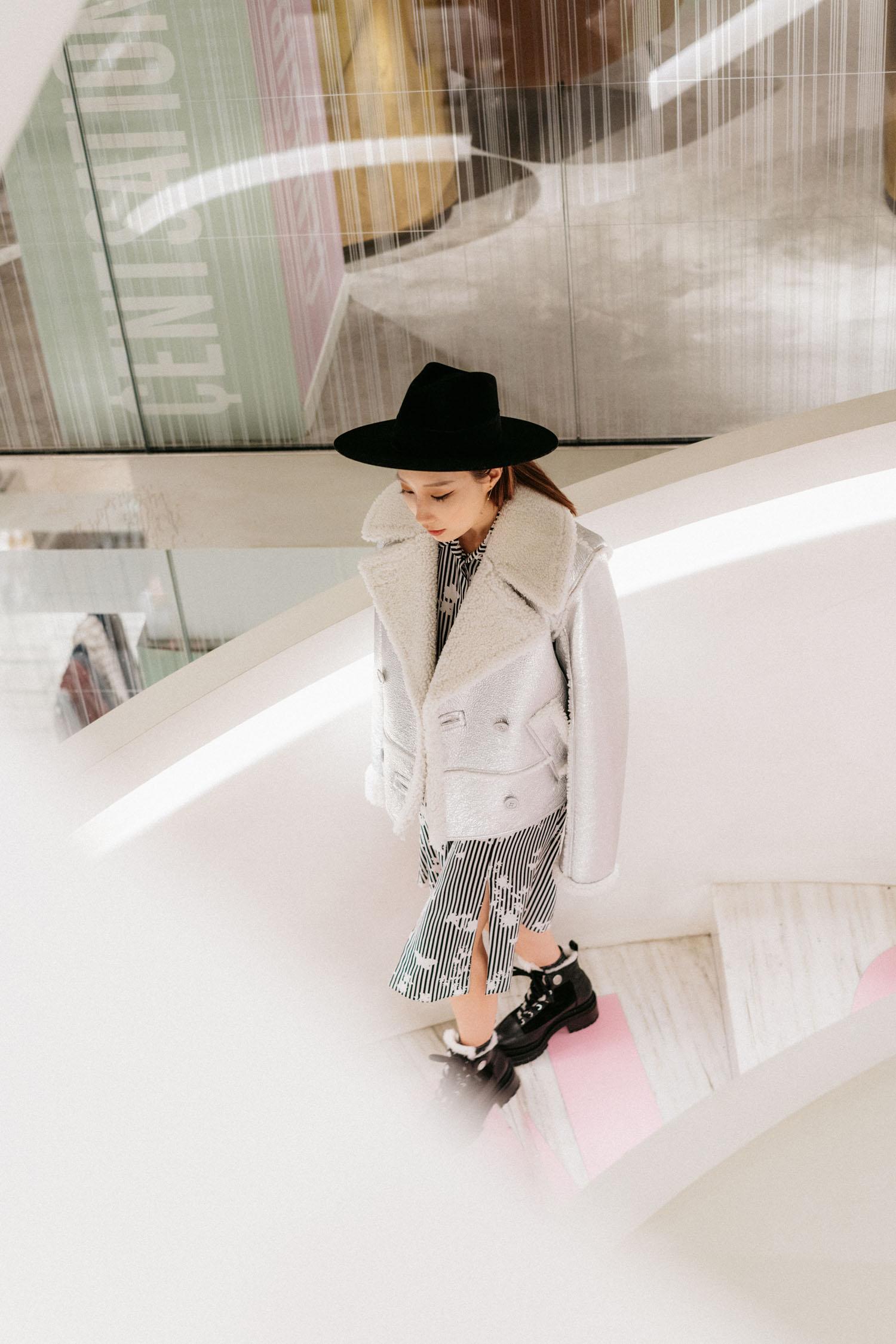 Barneys New York Downtown wearing  Sies Marjan Coat , Altuzarra Dress,  Pierre Hardy Boots ,  Janessa Leone Hat