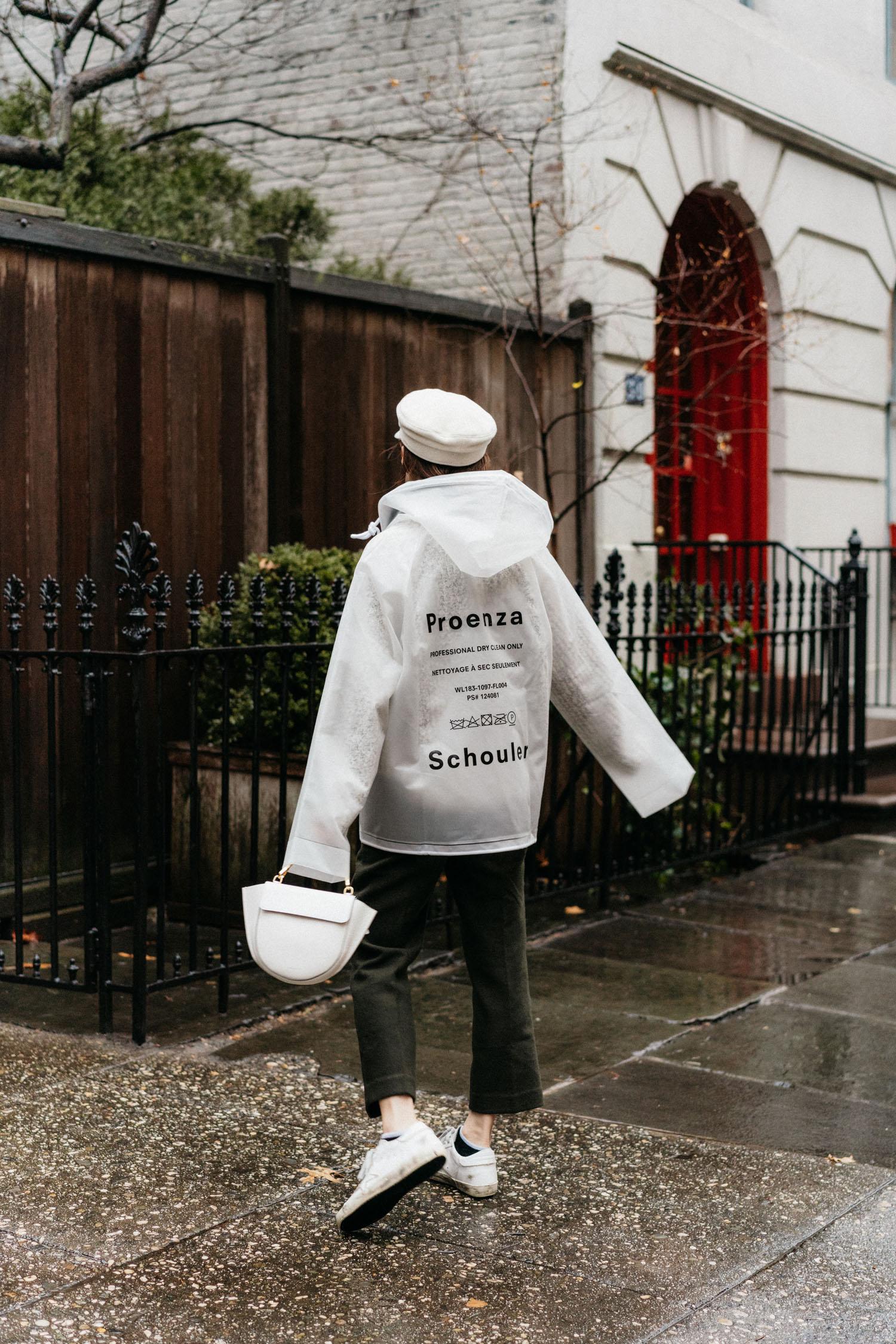 Proenza Schouler Jacket,  Petite Studio Pants ,  Golden Goose Sneakers ,  Wandler Bag ,  Ruslan Baginskiy Hat , Linda Farrow Glasses