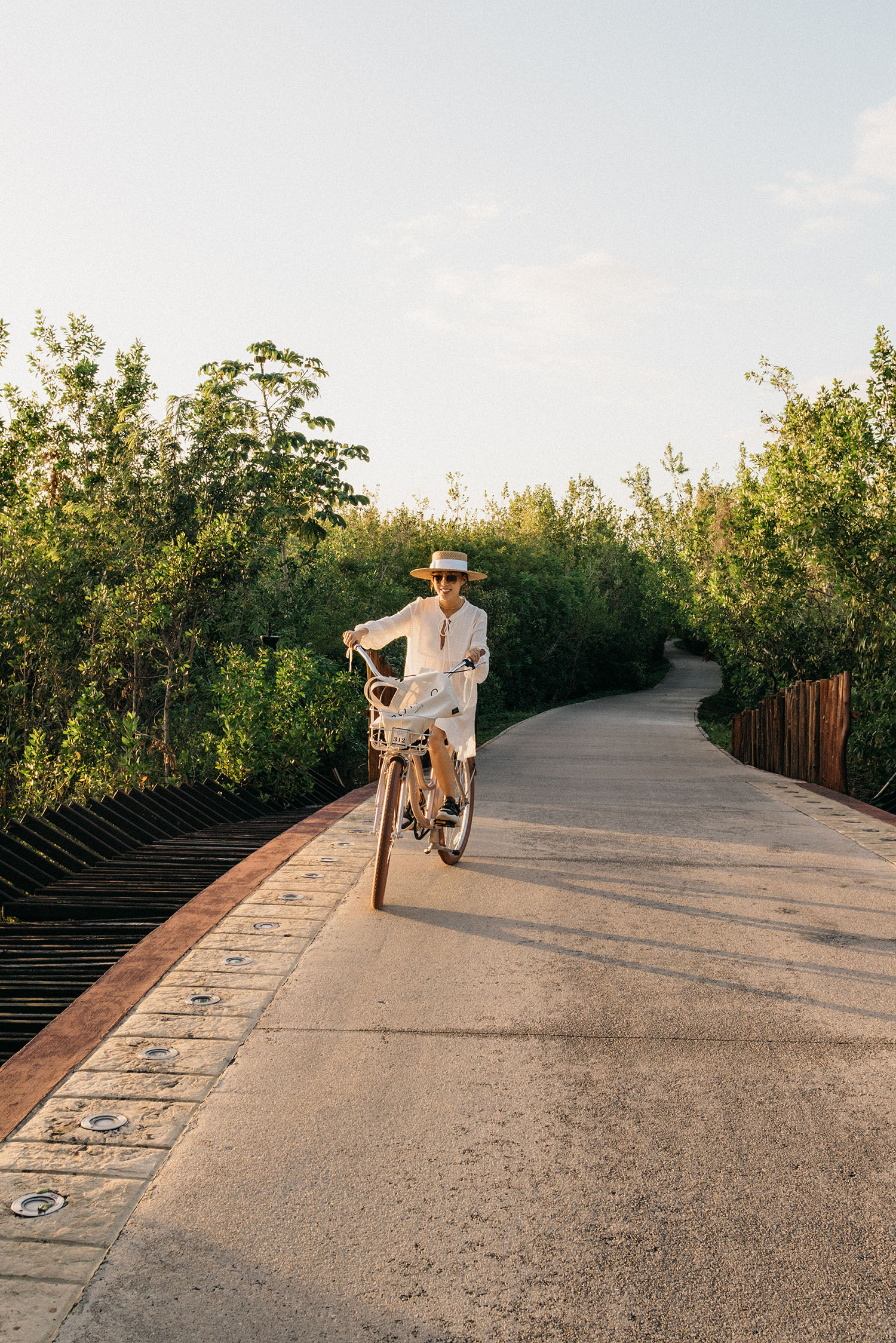 Bikes to ride around the property – en route to dinner! Wearing Natalie Martin Dress,  Chloé Sneakers ,  Eric Javits Hat