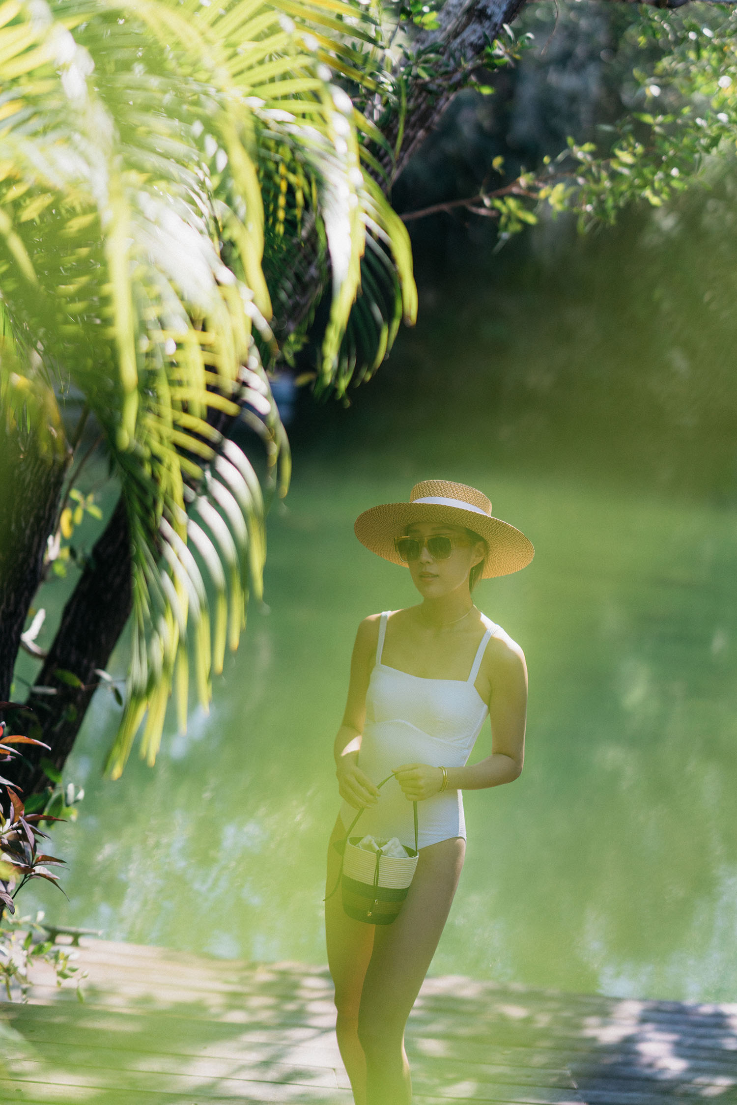 Asceno Swimsuit ,  Cesta Bag ,  Eric Javits Hat ,  Céline Sunglasses
