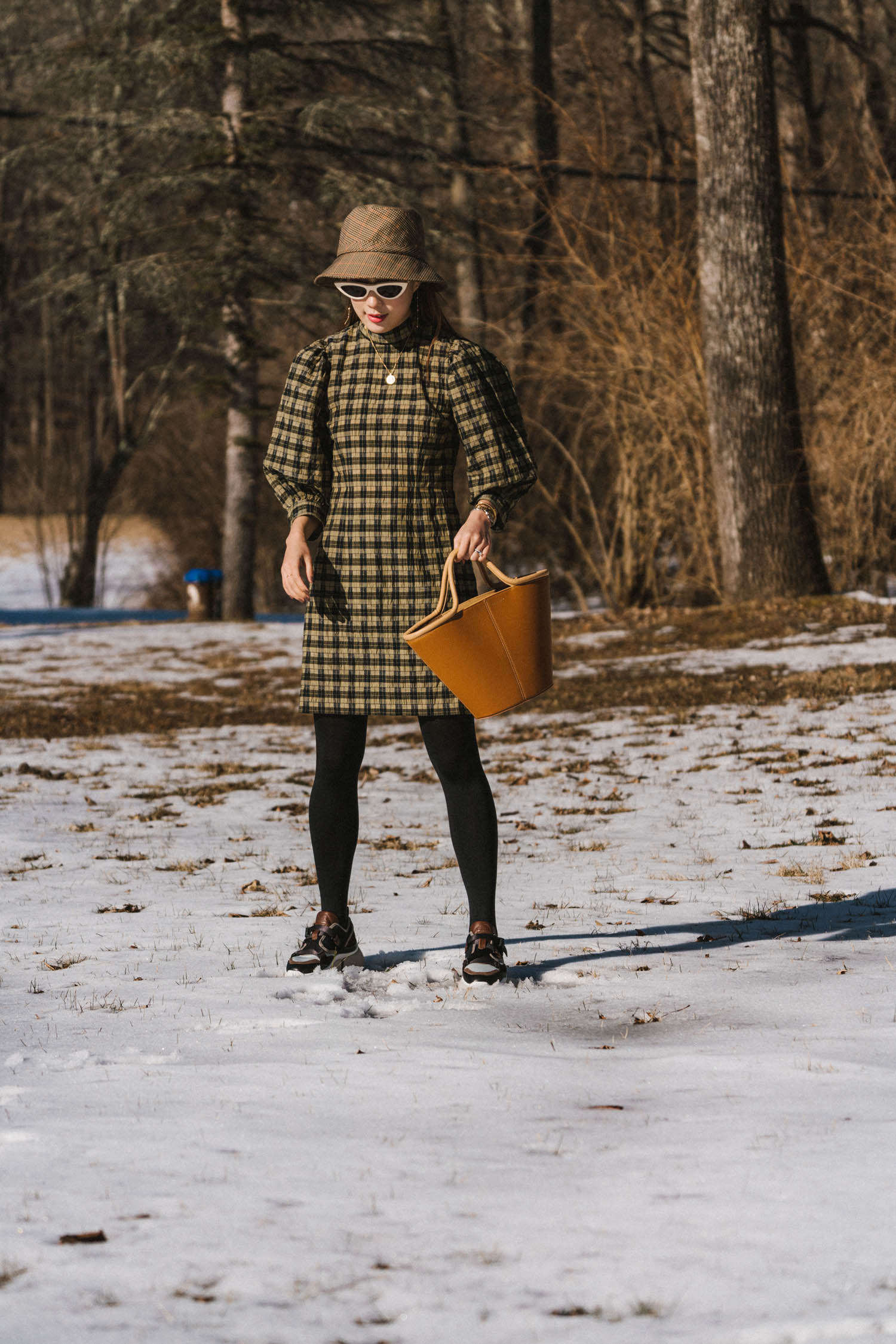 Ganni Dress ,  Wolford Tights ,  Chloé Sneakers ,  Cuero & Mor Bag ,  Céline Sunglasses ,  Eric Javits Hat
