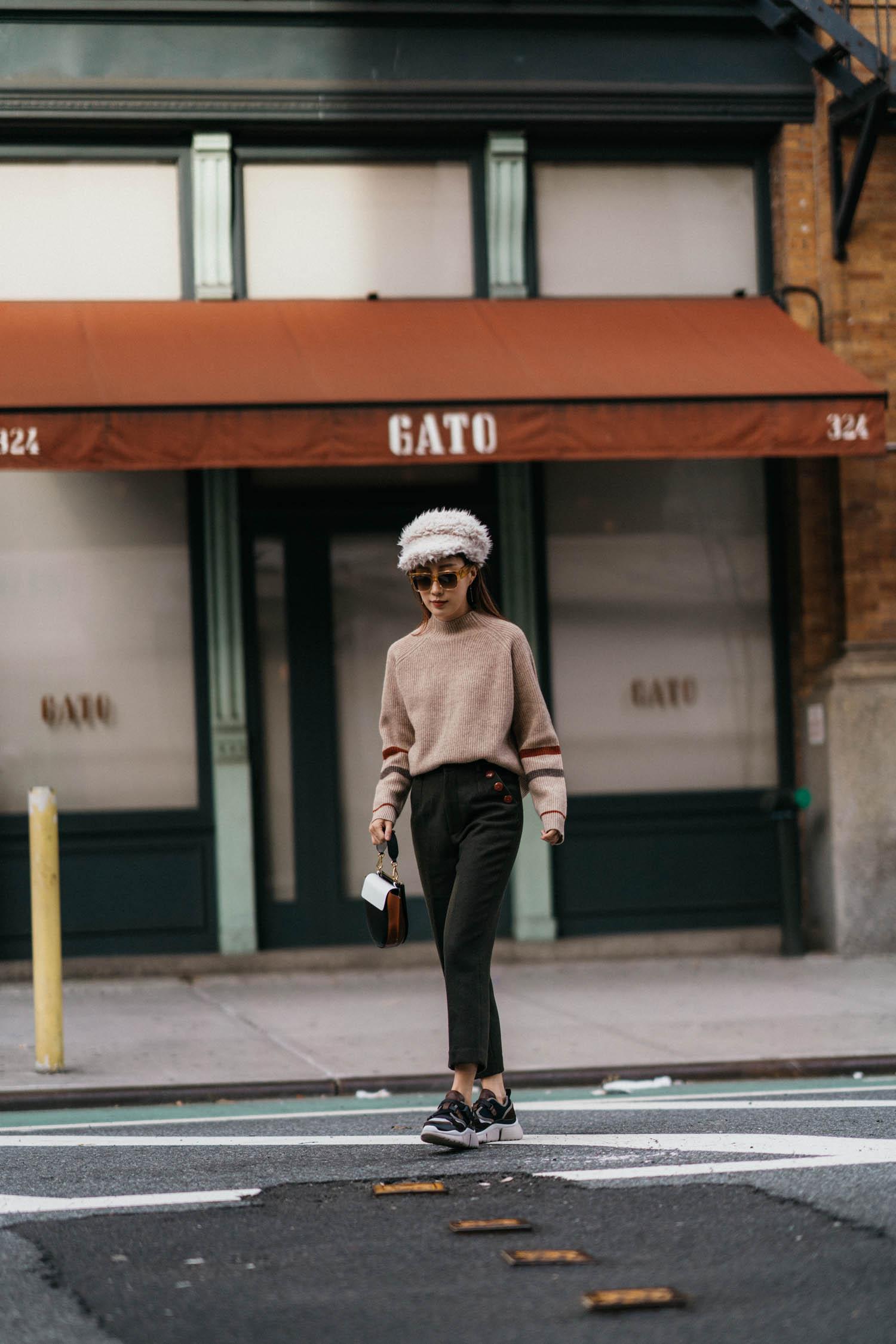 Petite Studio Sweater ,  Petite Studio Pants ,  Wandler Bag , House of Lafayette Hat,  Celine Sunglasses