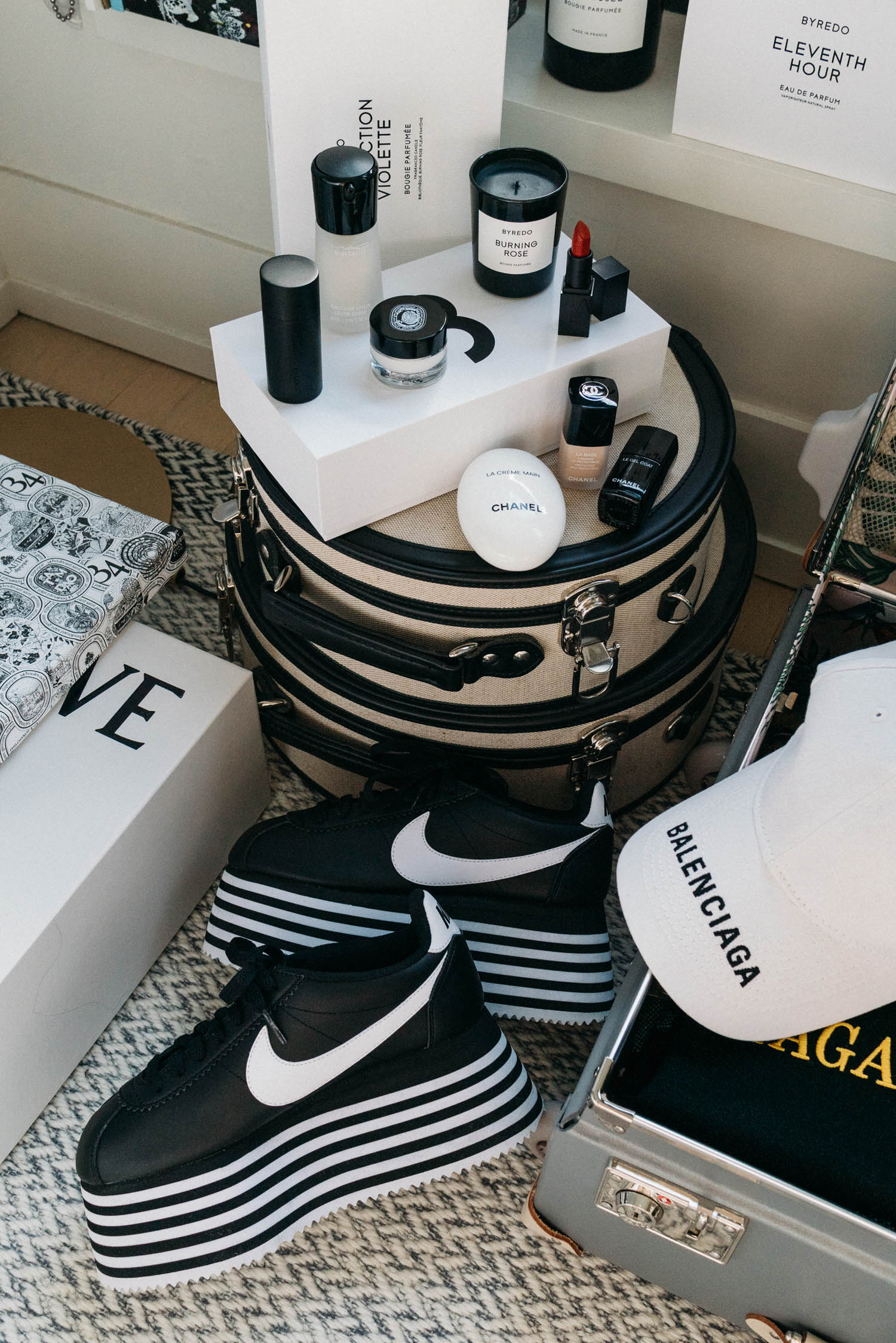 Comme des Garçons Sneakers ,  Balenciaga Hat ,  CHANEL Hand Cream ,  CHANEL Base Coat ,  CHANEL Top Coat ,  Byredo Candle ,  NARS Lipstick ,  Diptyque Cream ,  MAC Cosmetics Lotion ,  Gucci Westman Highlighter